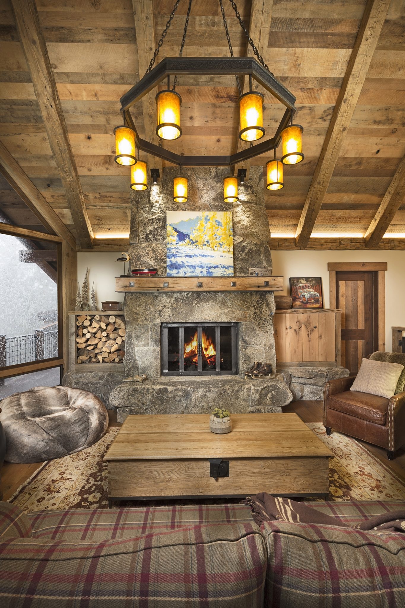 Rustic Family Lodge, Lake Tahoe, great room stone fireplace and chandelier by Aspen Leaf Interiors, Inc.