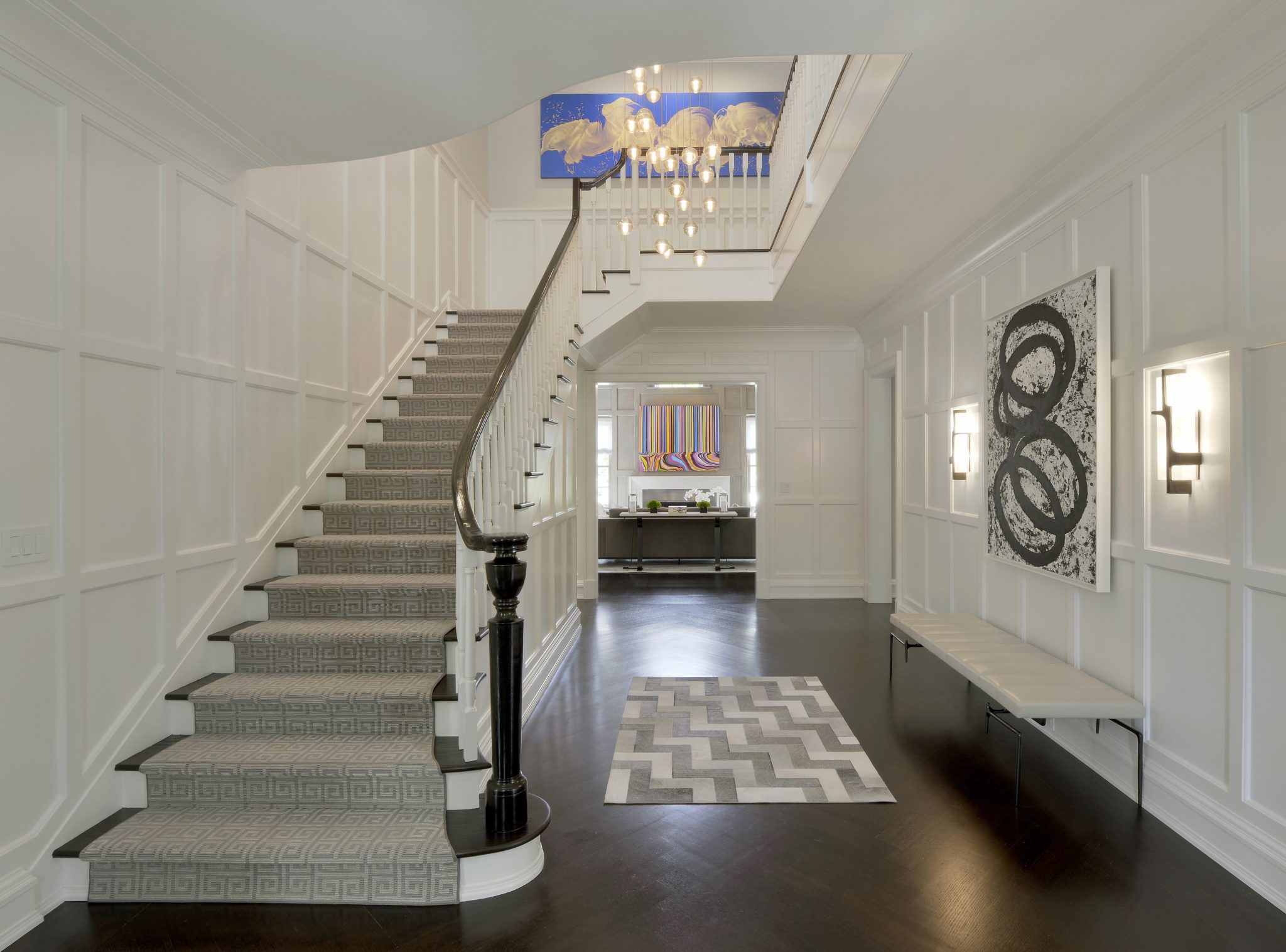 Stair hall with paneled walls by Alisberg Parker Architects