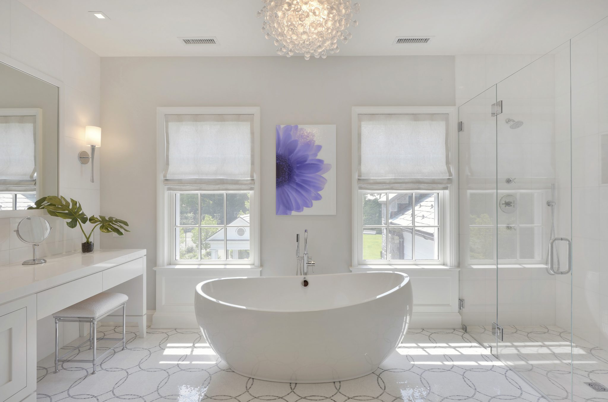 Modern white bath with freestanding tub by Alisberg Parker Architects