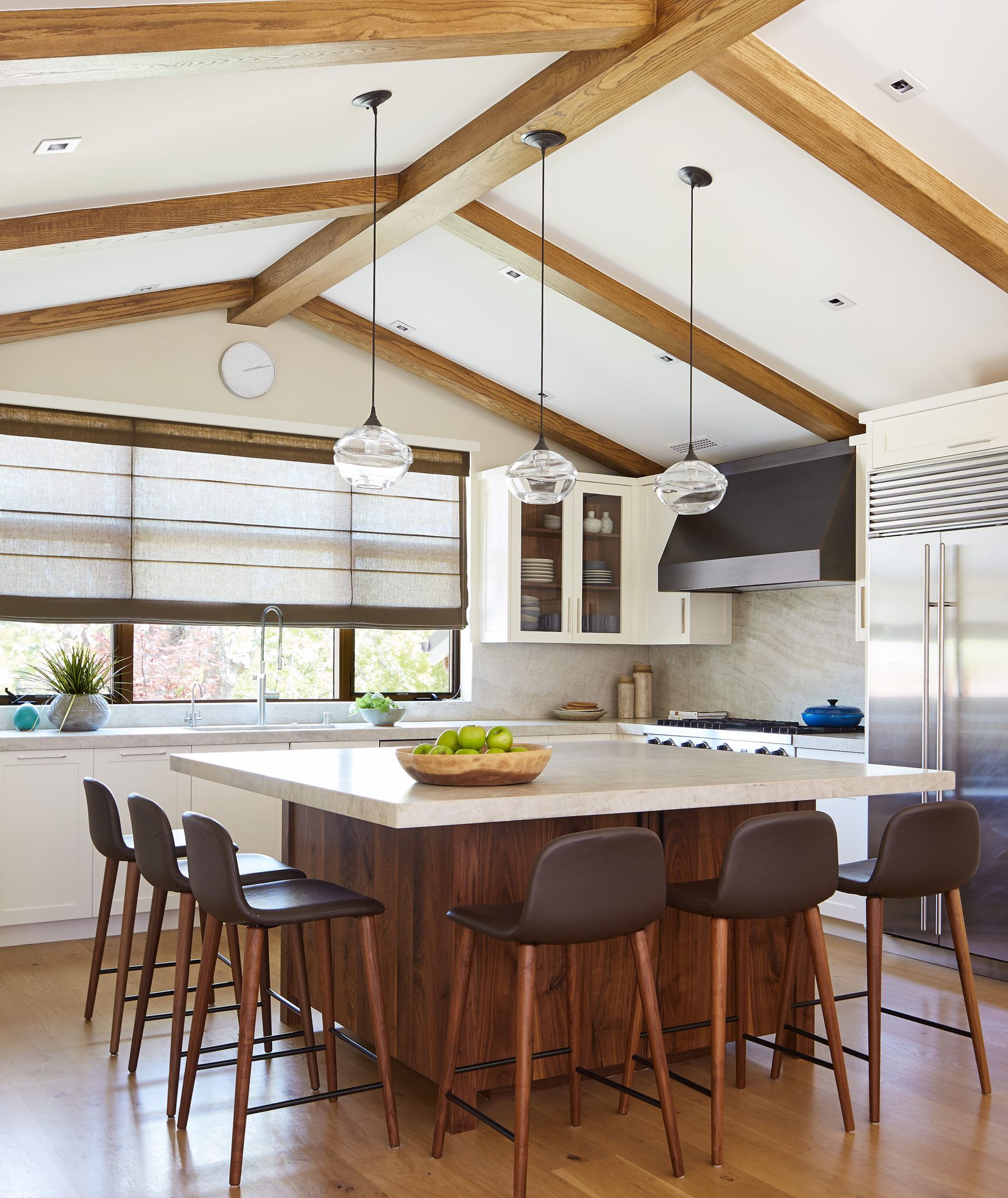 Large Kitchen island is ideal for the family to gather, cook and work by Staprans Design
