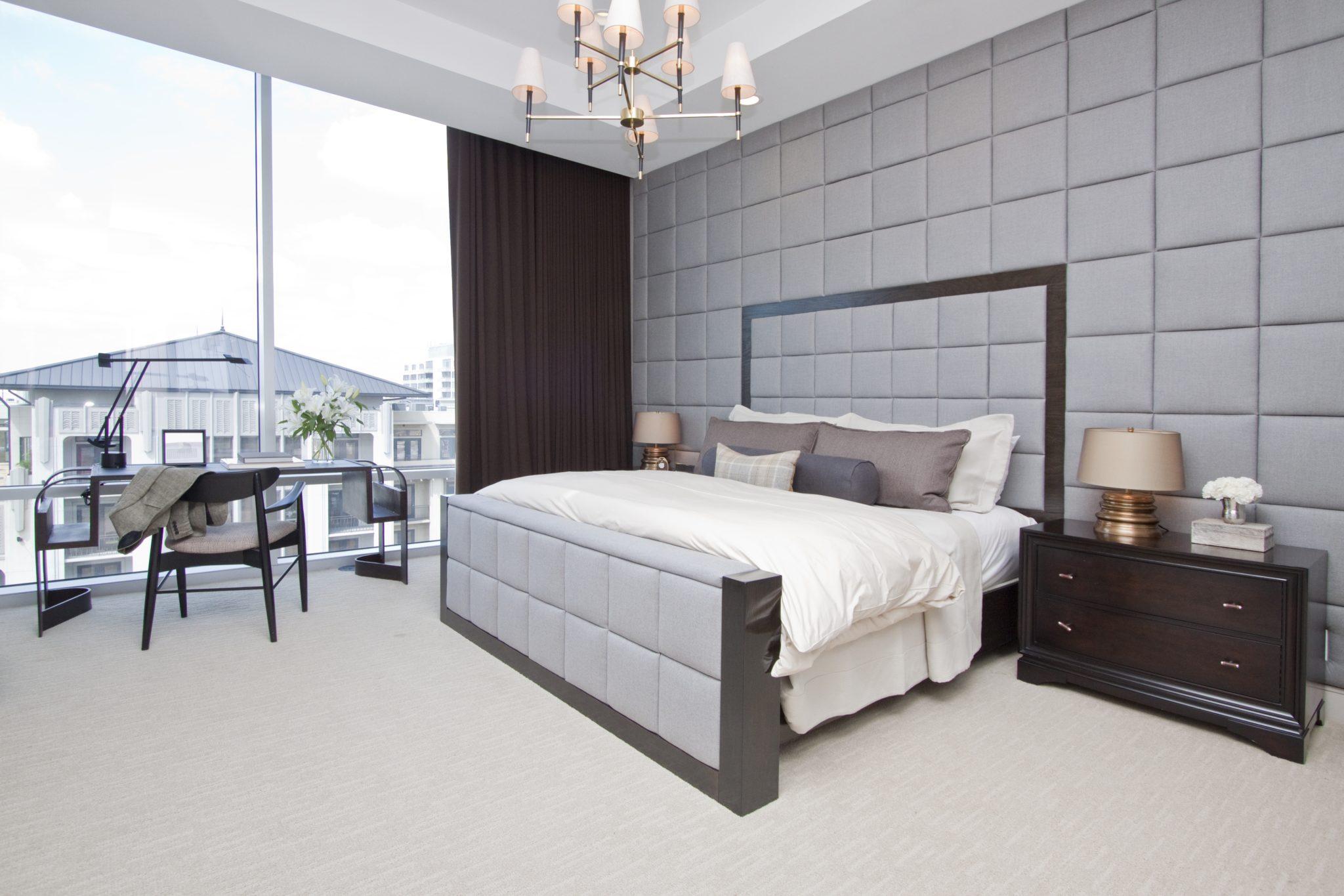 A calming, gray bedroom in Houston, Texas, by Blair Gordon Design