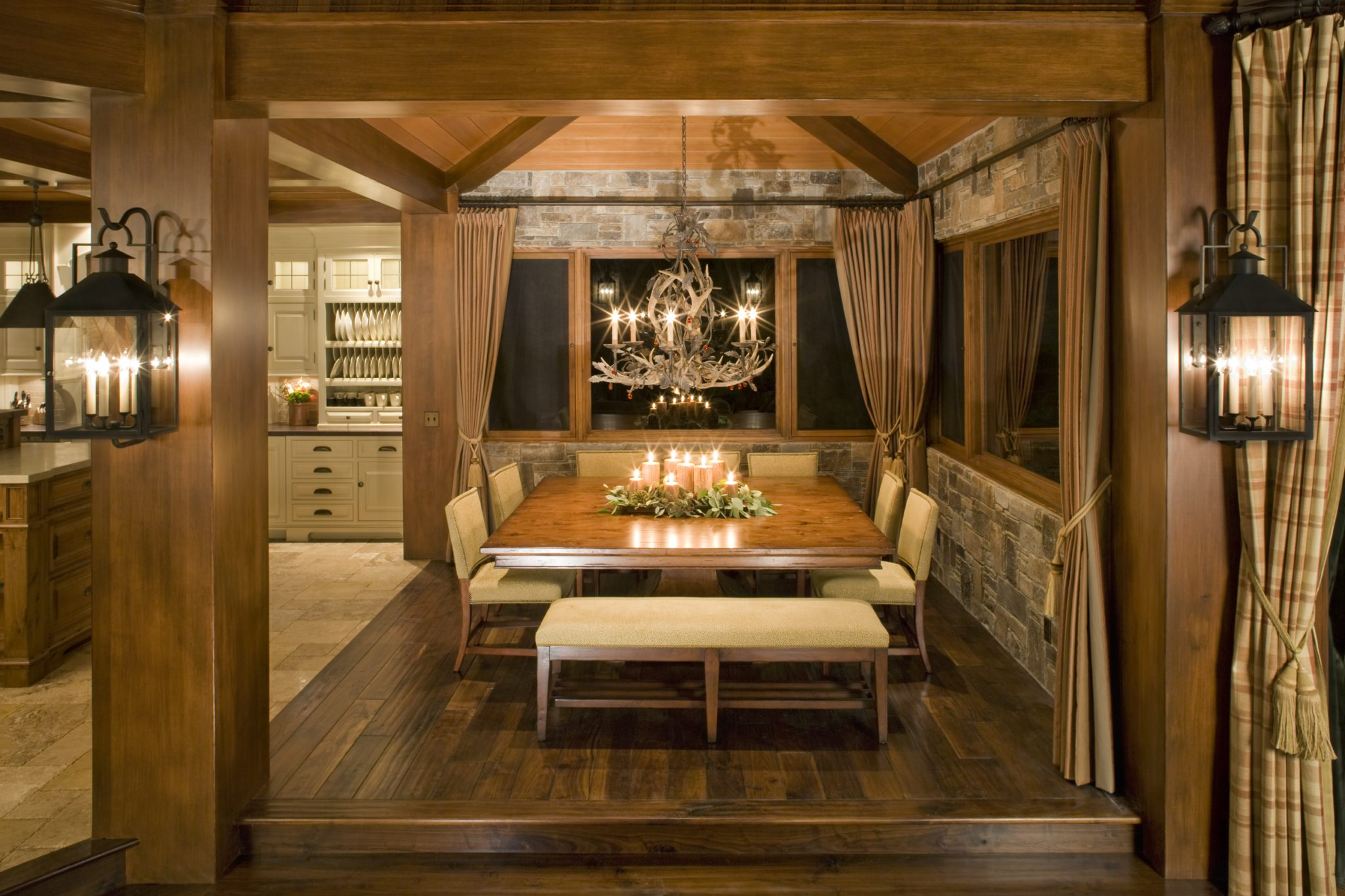Traditional Mountain home in Mammoth, Dining Area with stone walls by Brown Design Group