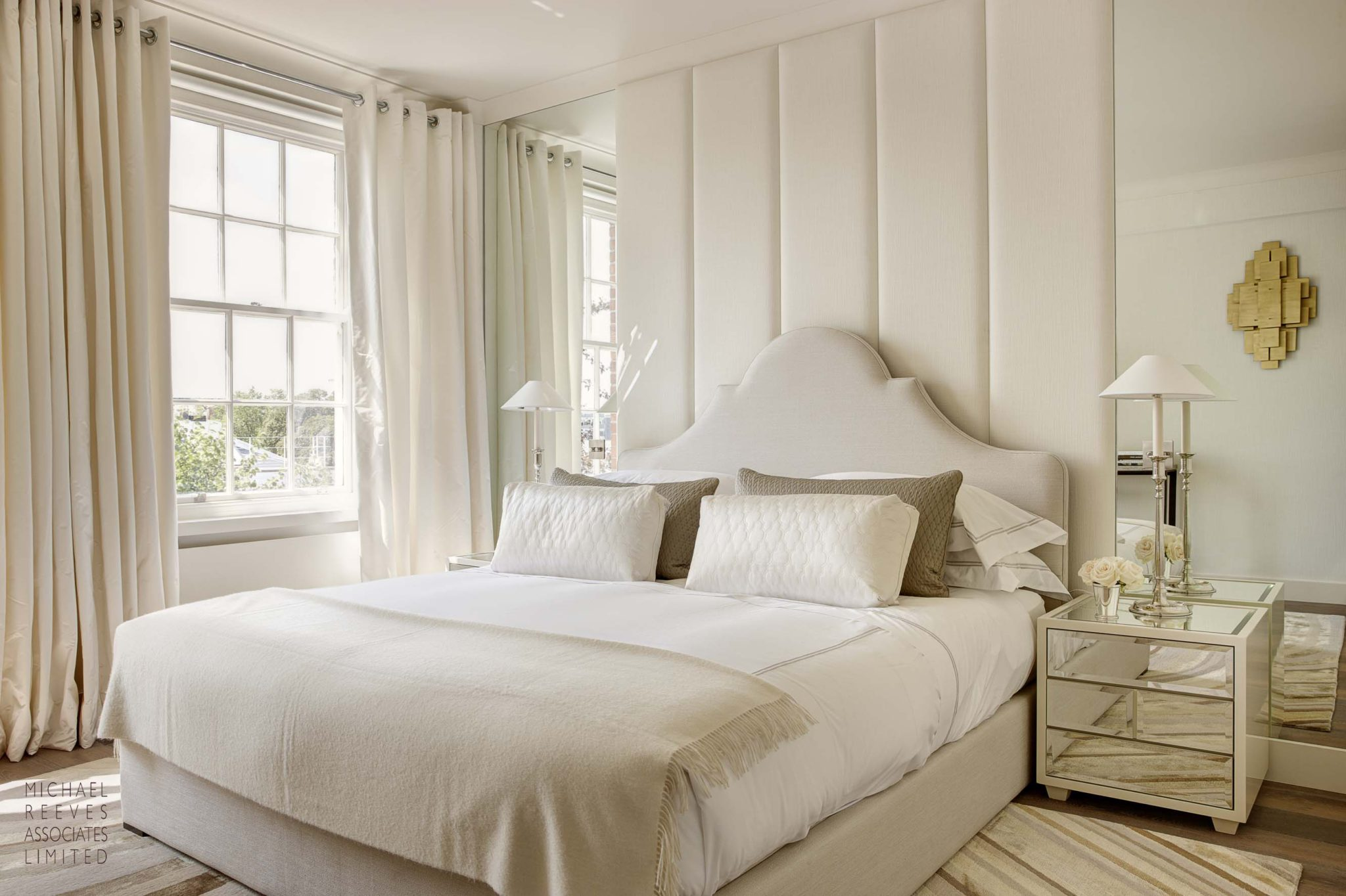 Notting Hill apartment guest bedroom by Michael Reeves Associates