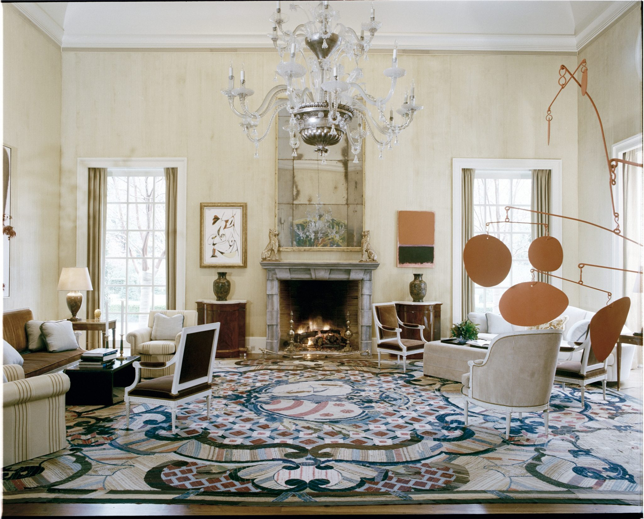 Large living room with modern art, large, colorful rug by Stephen Sills Associates