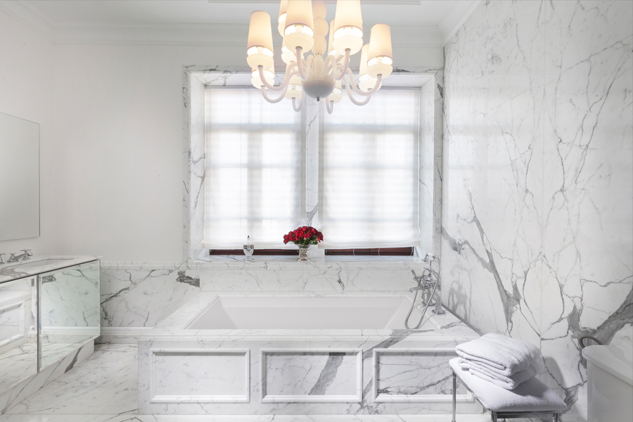 Refined and impressive Stattuario marble bathroom provides ethereal light. by Annette Frommer Interior Design