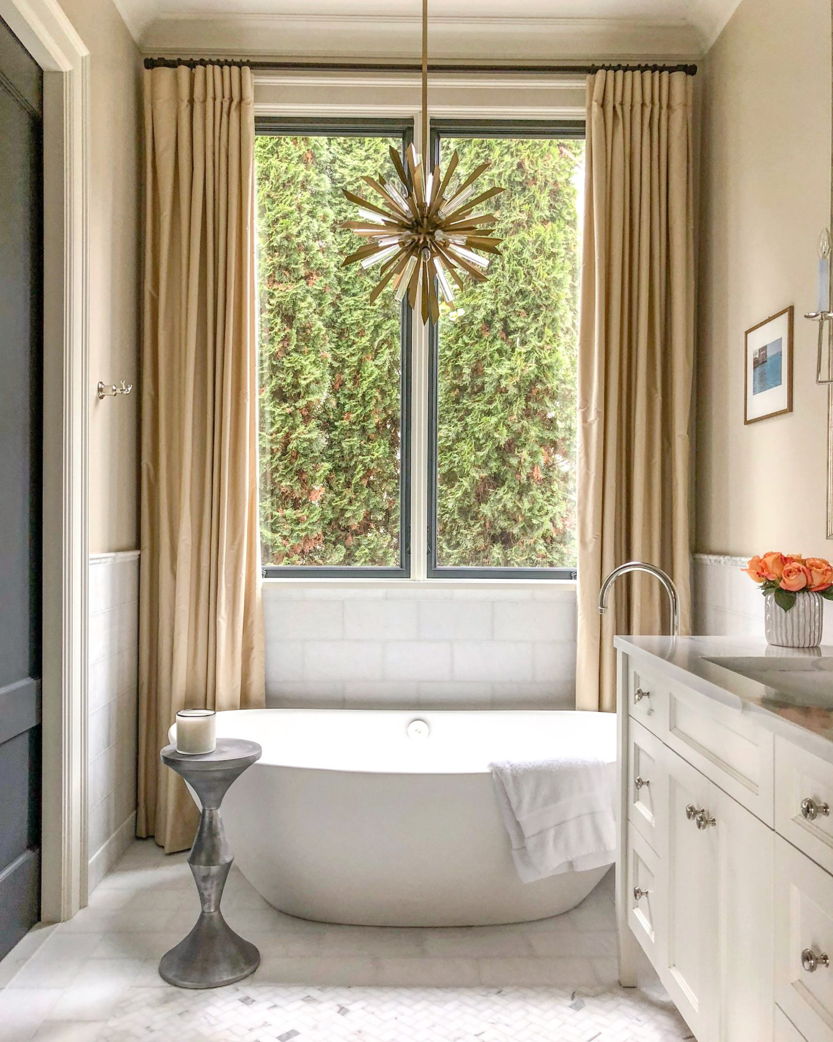 Mercer Island Marble Bath with Freestanding Tub, Black Doors, Marble Counters by LeeAnn Baker Interiors Ltd.