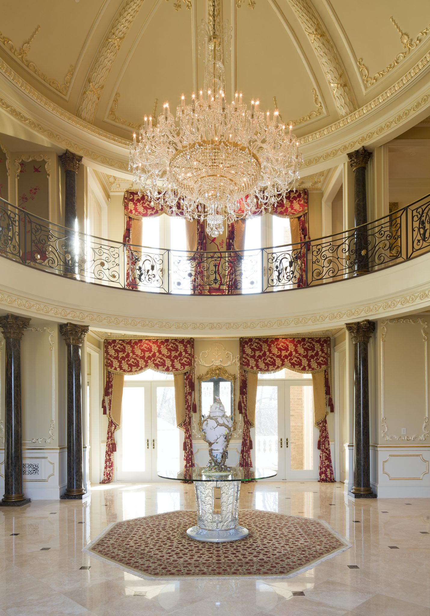 The 20' wide by 32' high dome features a 10-foot-wide Schonbek chandelier. by Haleh Design