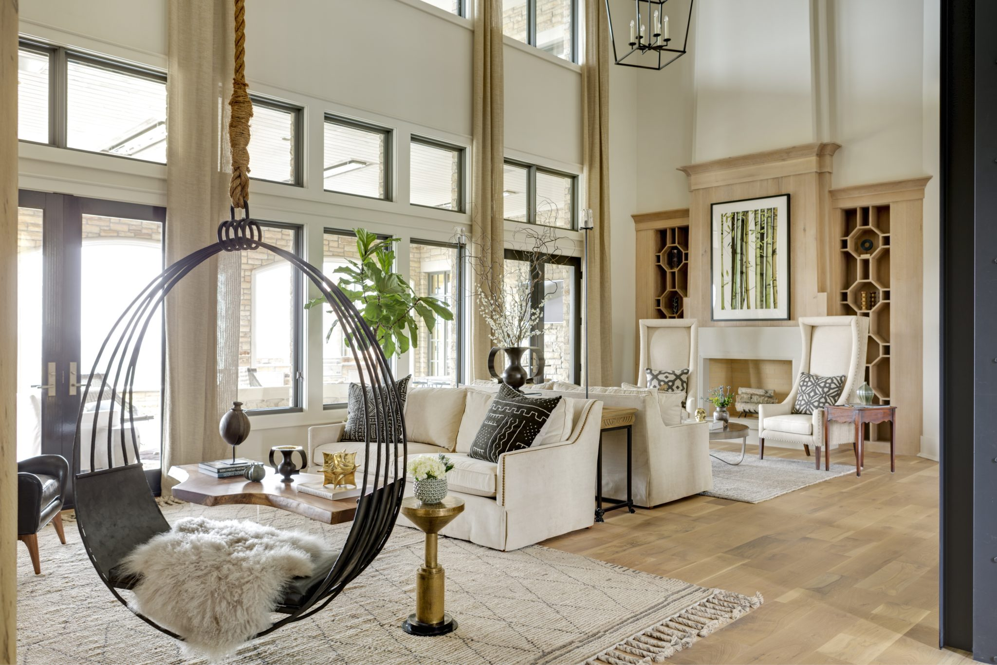 Horse Meadow country house featuring soaring ceilings and double fireplaces. by Casey Sarkin Interior Design, Luna Inc.