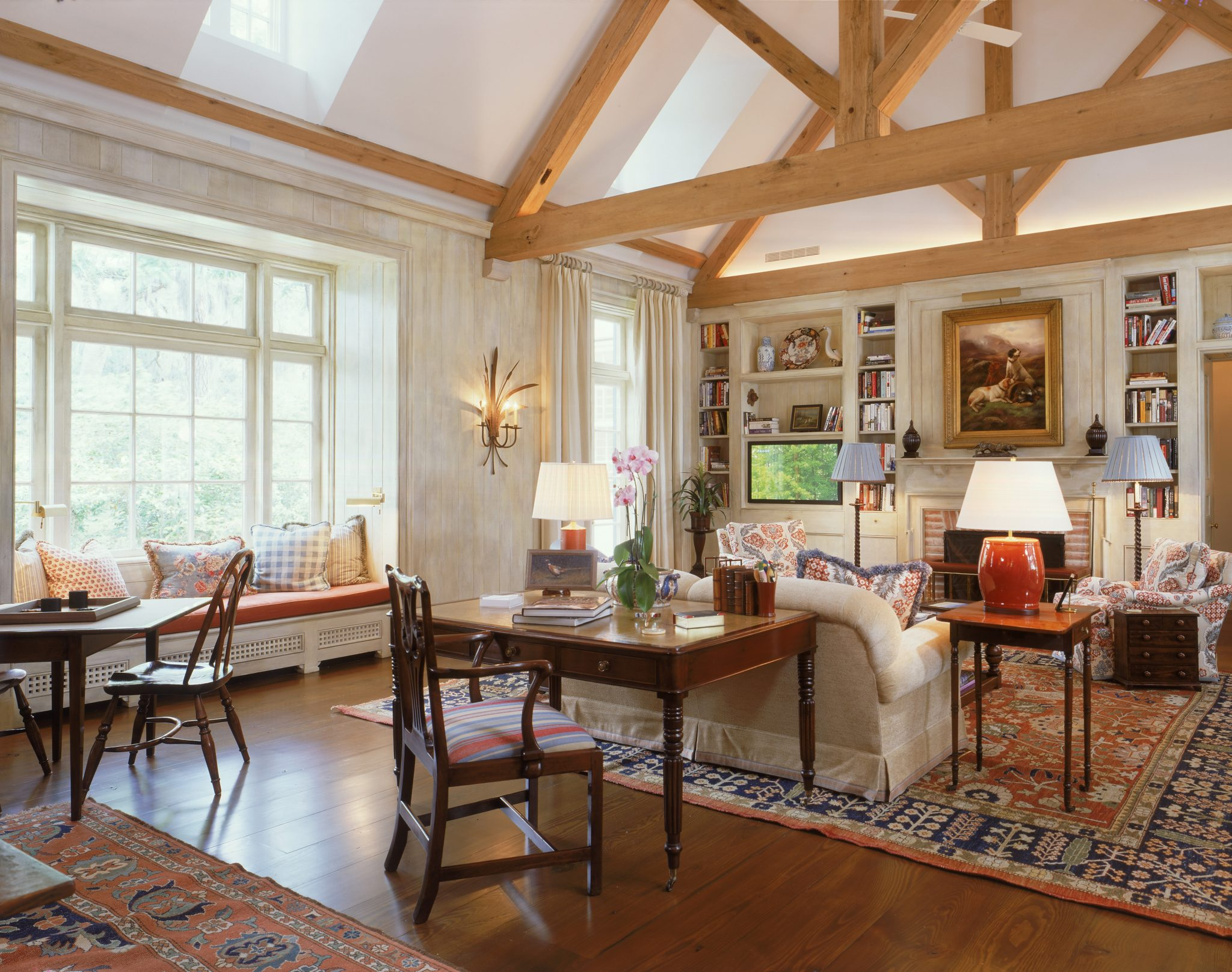 Wood beams define a soaring ceiling; floors are loblolly pine from the property. by Eric J. Smith Architect, PC
