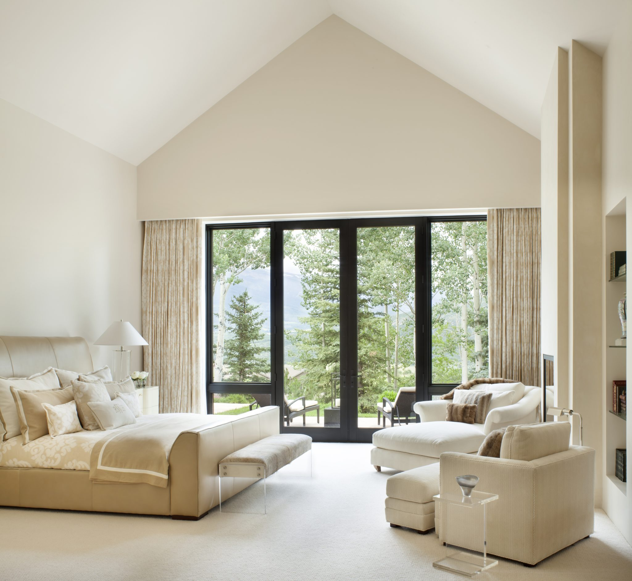 Bold windows and tall ceilings complete this master bedroom by Brewster McLeod Architects