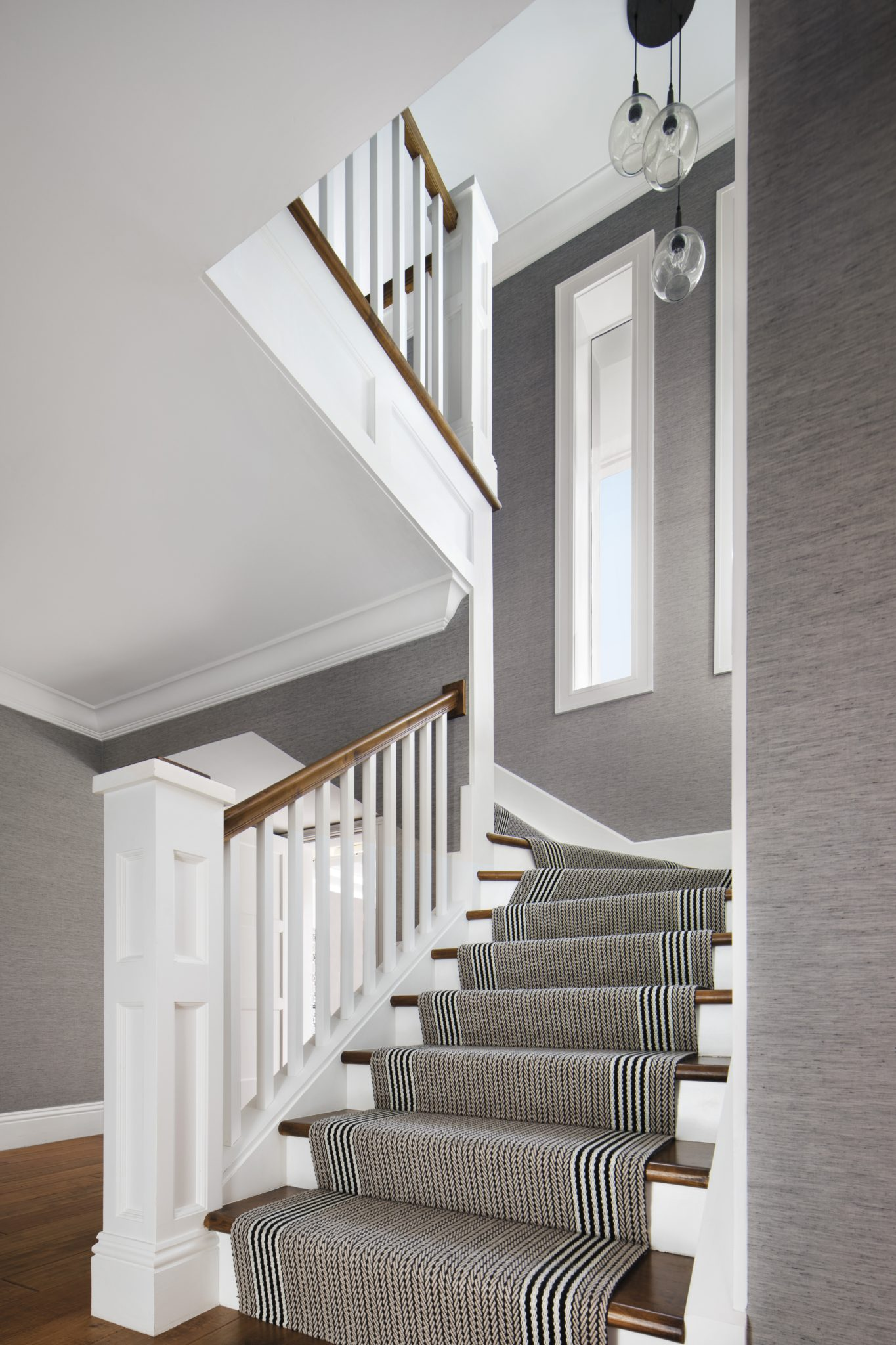 Staircase with Custom striped flat weave Runner and Linen Wallcovering by Lisa Michael Interiors