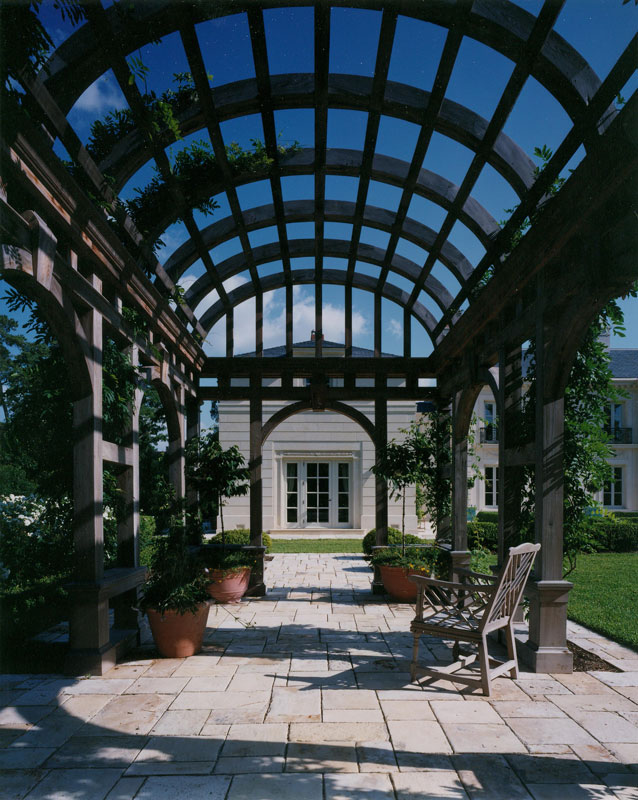 Barrel Vault Pergola at the Inverness Residence, Houston by Curtis & Windham Architects