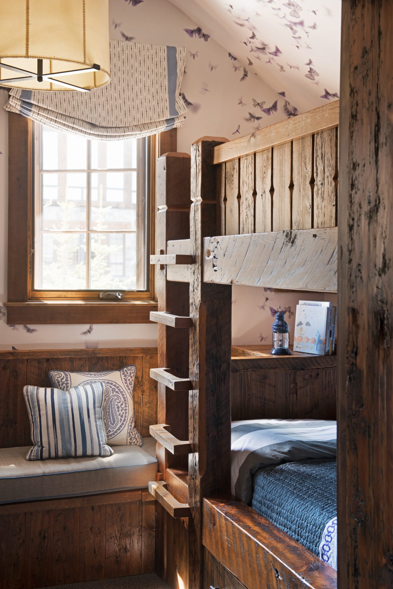 Montana Mountain Retreat Bunk Room with Custom Built Bunk Beds and Cabinets by Kelly Hohla Interiors