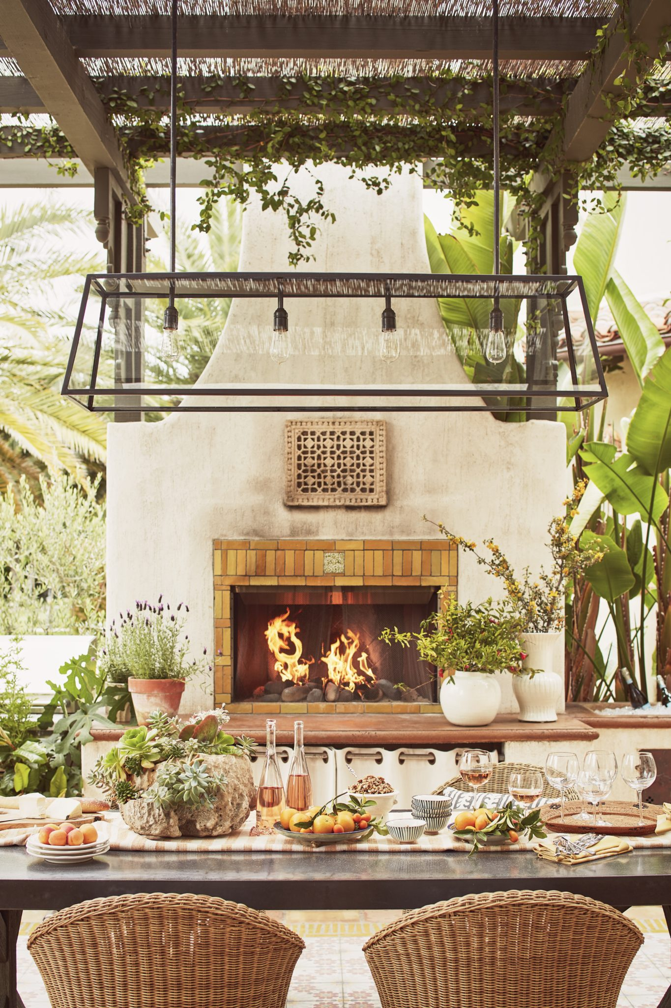 Malibu Spanish Colonial, Courtyard Outdoor Dining, Kitchen, Fireplace w/pergola by Interior Archaeology