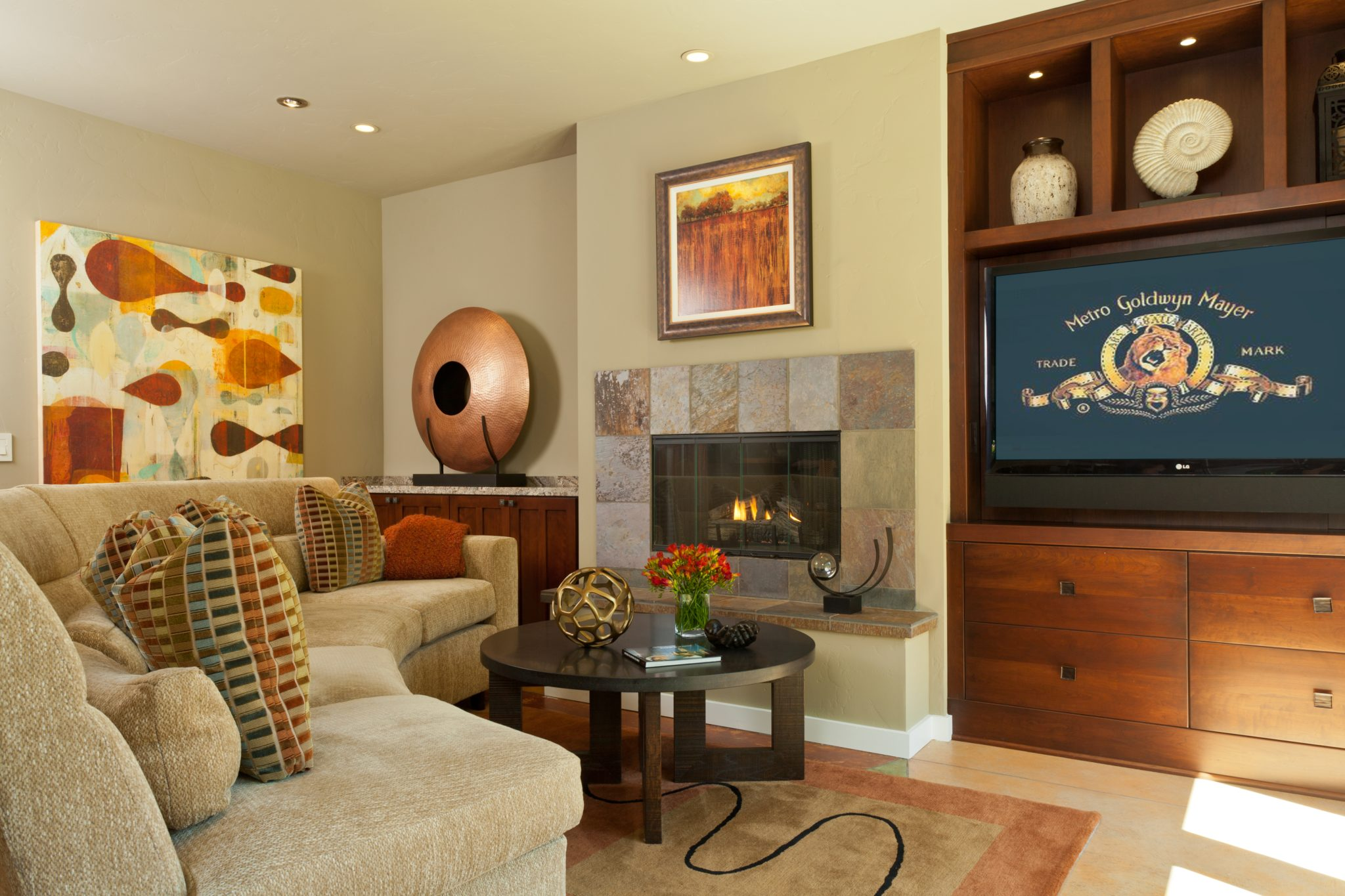 Family Room showcases curved sofa, slate fireplace and cherry built-ins by Alison Whittaker Design