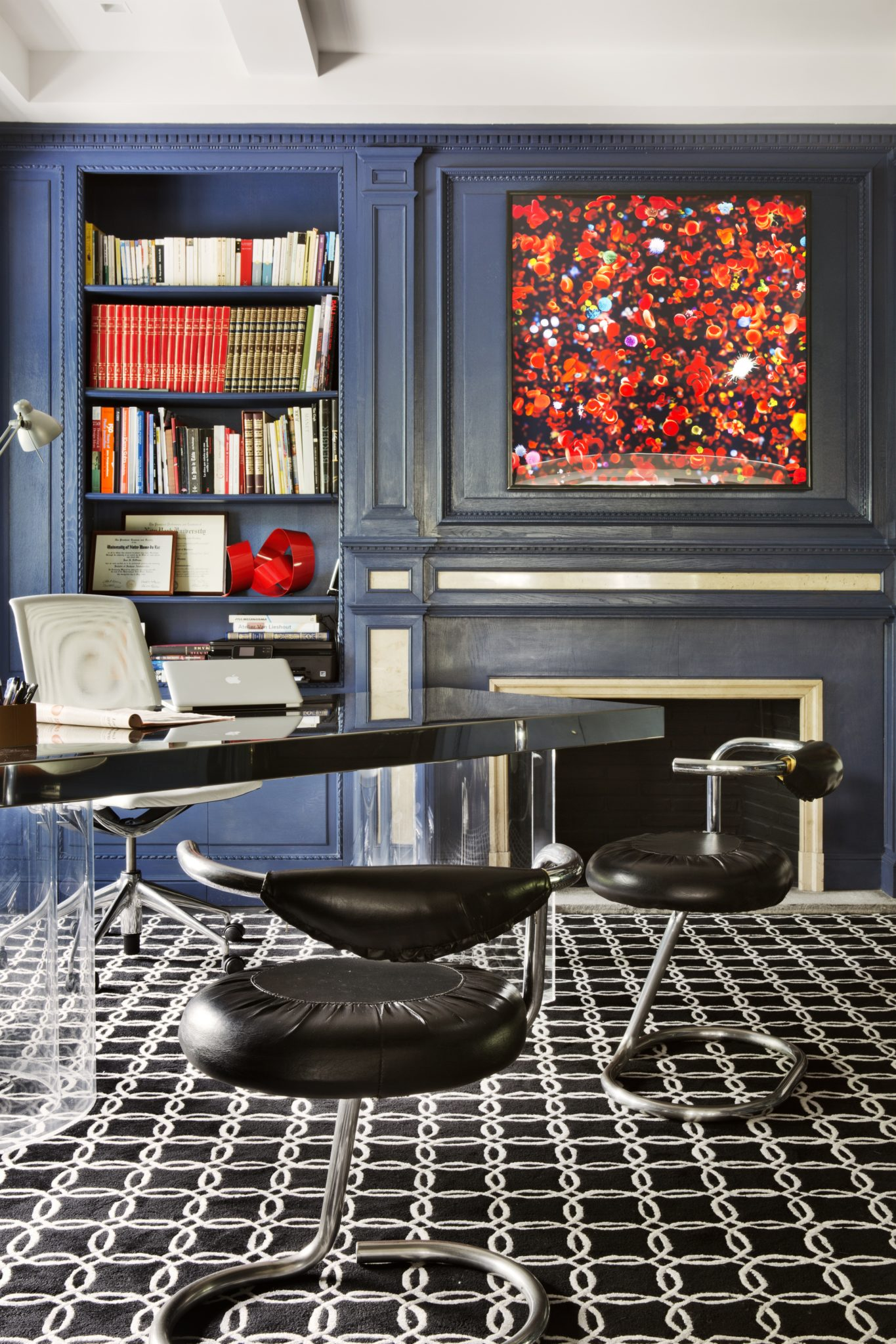 Sleek home office with paneled blue walls by Lorenzo Castillo