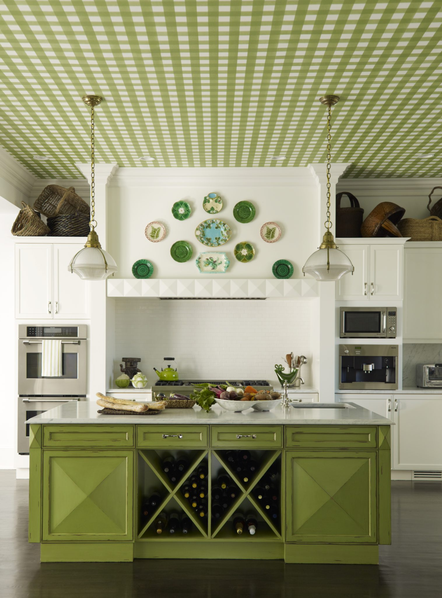 Purchase green kitchen with gingham wallpapered ceiling and island wine storage by Mendelson Group, Inc.
