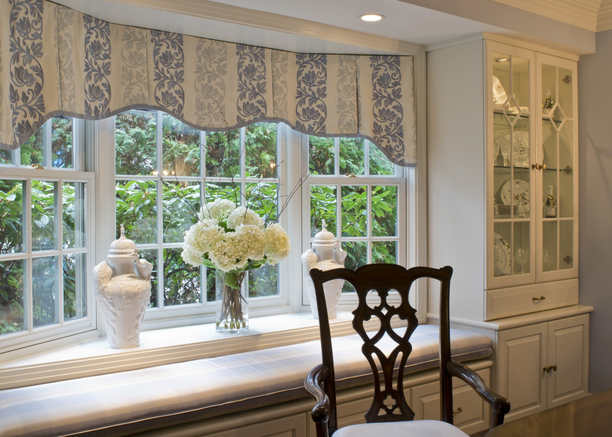 1938 Fieldstone dining room window seat with built-in china cabinets by LSM Interior Design