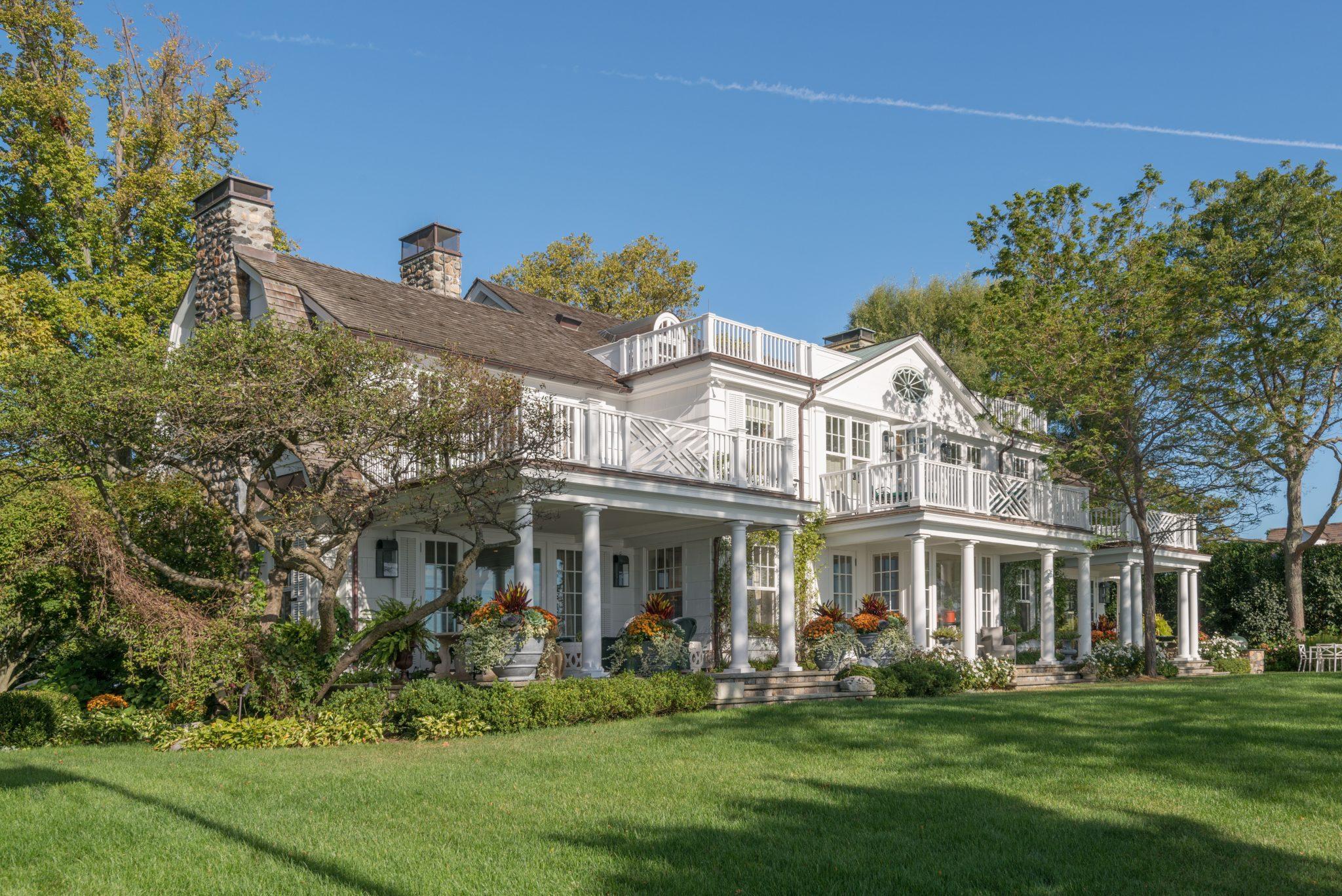 Generous porches extend public rooms as do decks off the bedroom suites. by Eric J. Smith Architect, PC