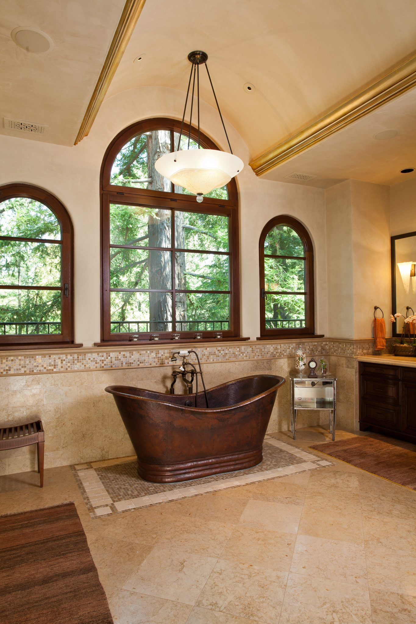 Master bath with barrel vault ceiling, arched windows and a freestanding bathtub by Alison Whittaker Design