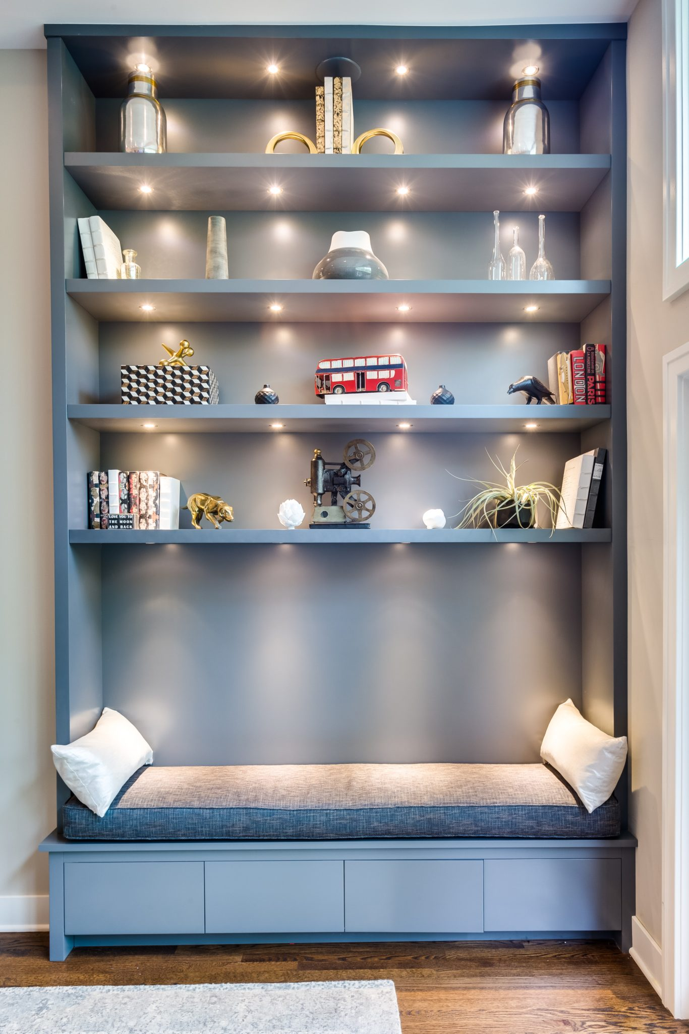 Urban Parlor - living room with gray built-ins and built-in bench by Rae Duncan Interior Design