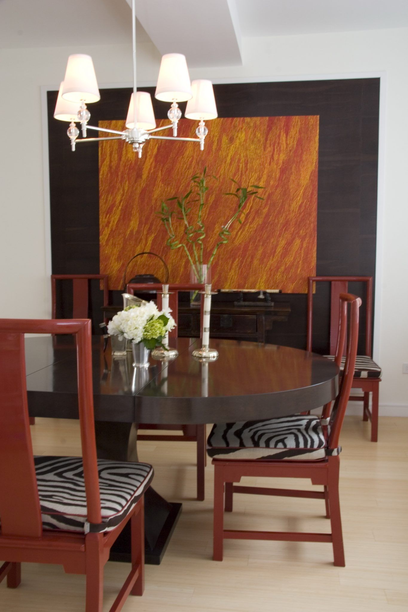 New York City dining room with art as a major feature setting the tone by Rinat Lavi Interiors