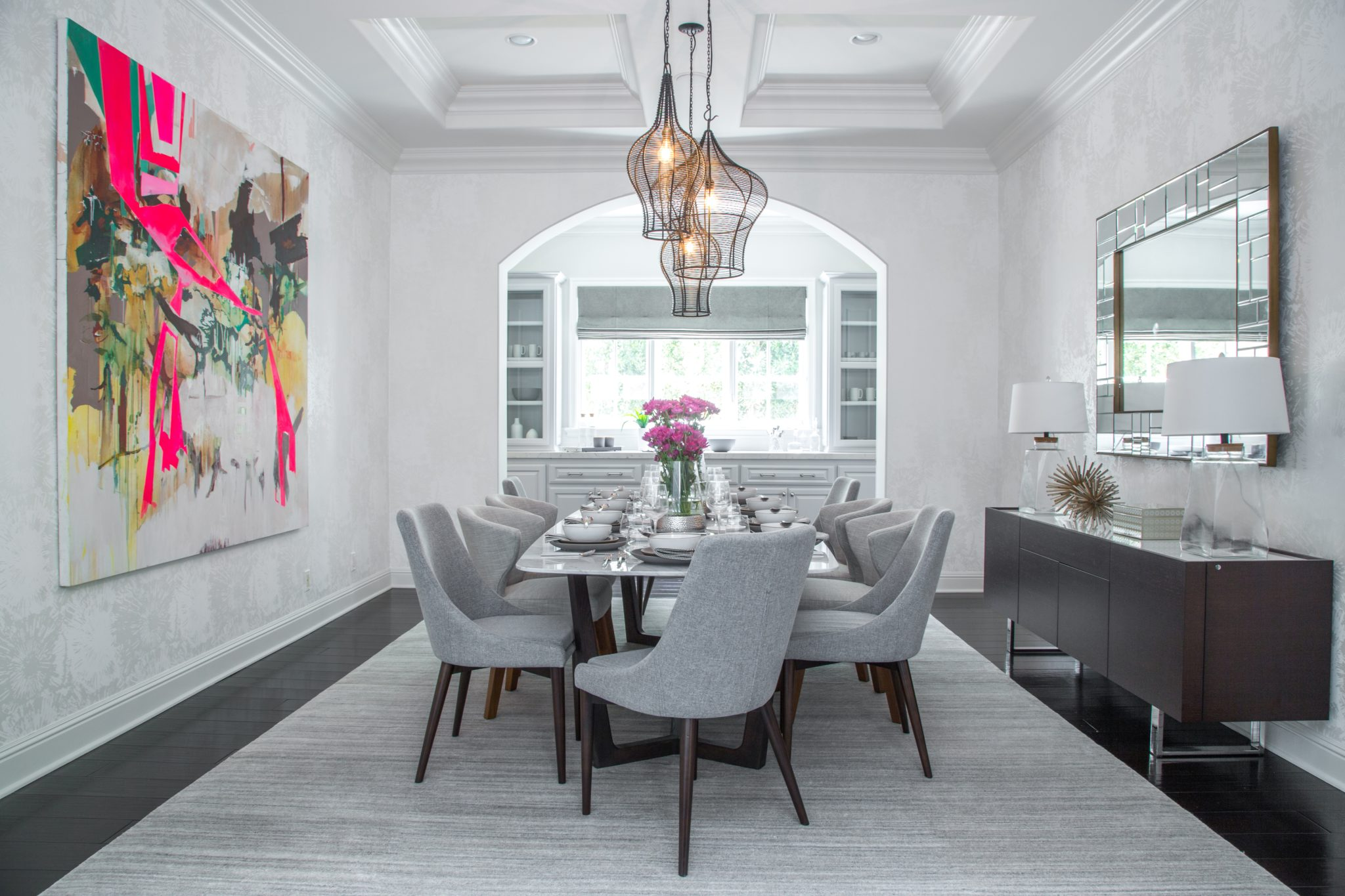 A dining room with statement art by dmar Interiors