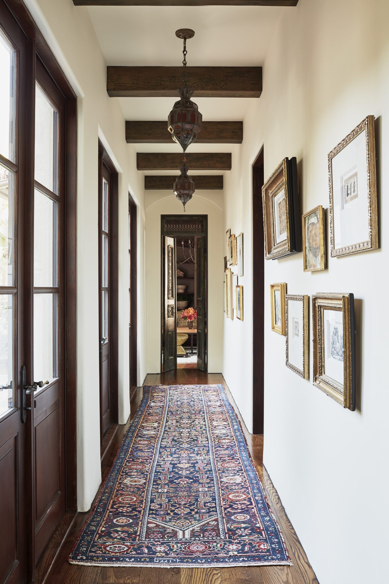 Malibu Spanish Colonial, Hallway Gallery with French Doors, Fine Art & Antiques by Interior Archaeology
