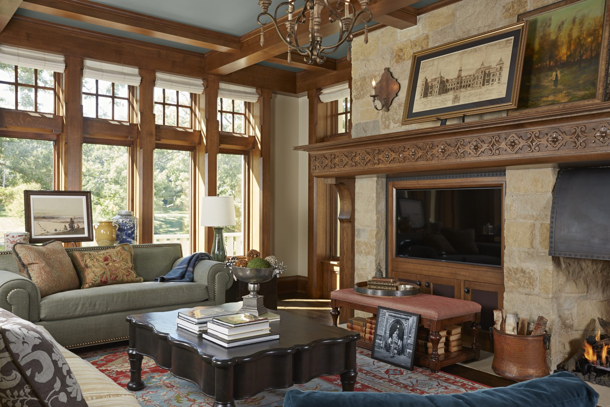 Tudor ceiling beams and Edwardian carved fireplace mantel - Minnesota by Murphy & Co. Design