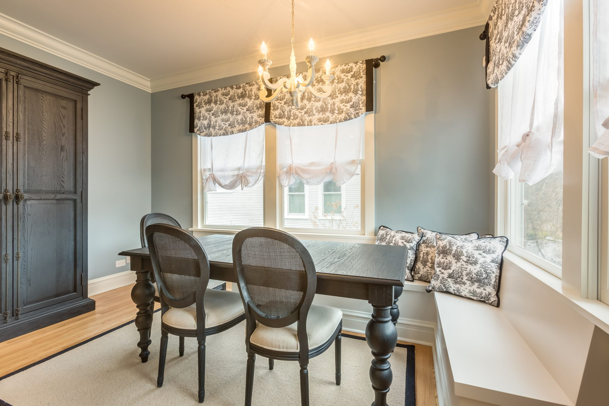 Victorian renovation - dining room with blue walls and white built-in bench by Rae Duncan Interior Design