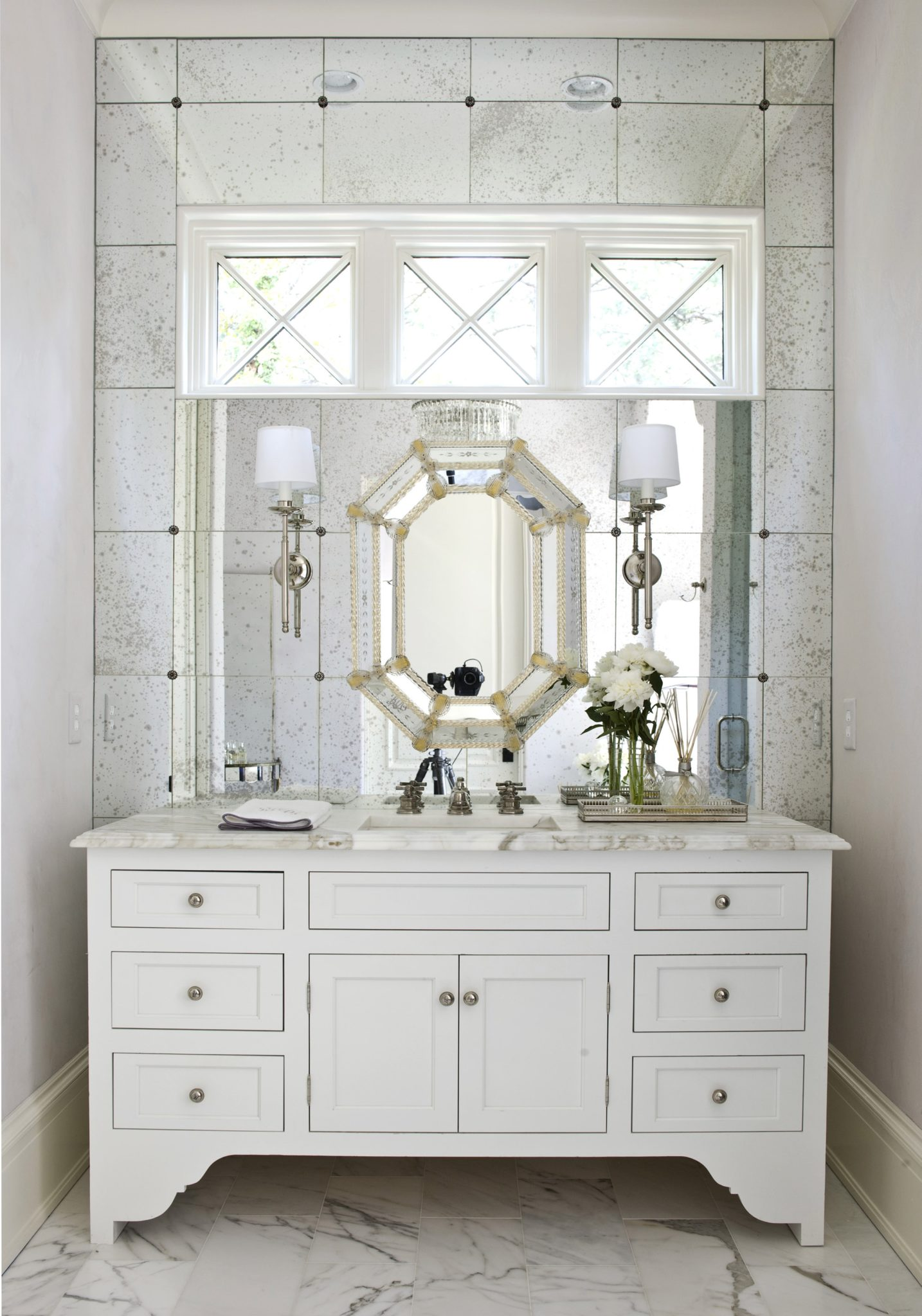 Authentic vanity with mirrored wall by Suzanne Kasler Interiors
