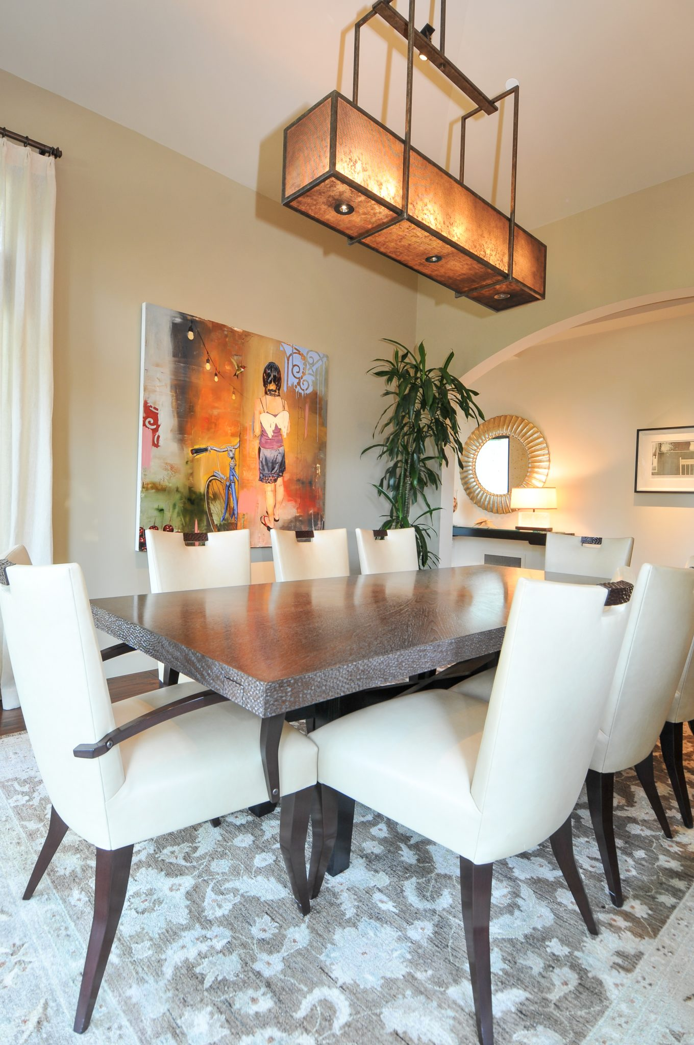 Dining room with Berman Rosetti chairs, Hammerton chandelier and original art by Alison Whittaker Design