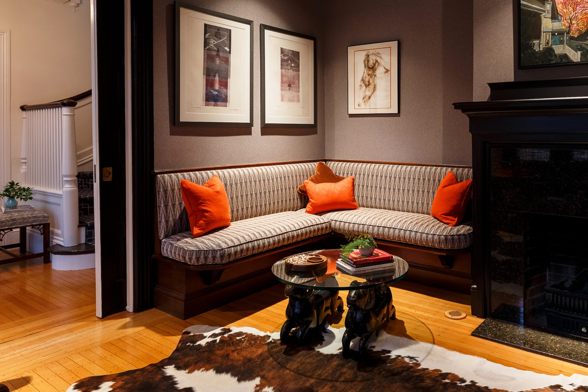 Bar with built-in bench, hide rug, and vintage ram base coffee table by SCS Design - Interiors by Sophia Shibles