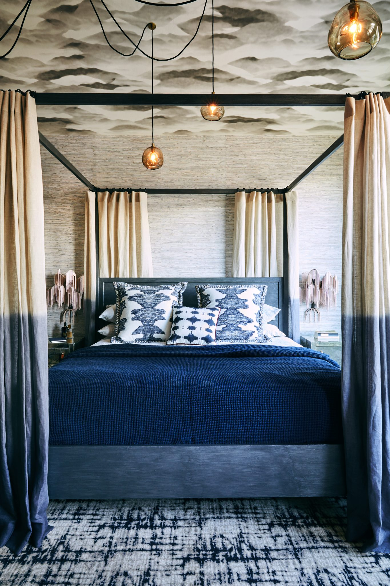Master bedroom with four-poster bed and ceiling wallpaper by Jeff Schlarb Design Studio