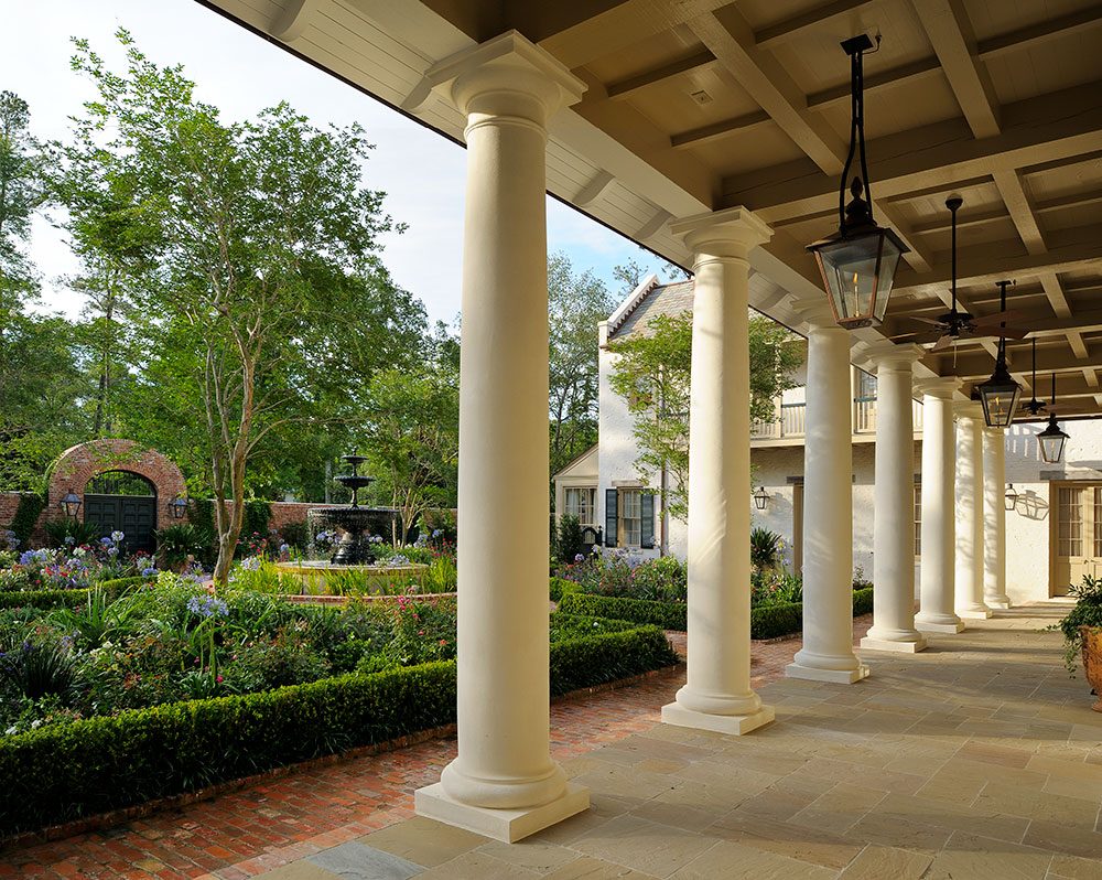 Colonnaded French Colonial porch. by Ken Tate Architect