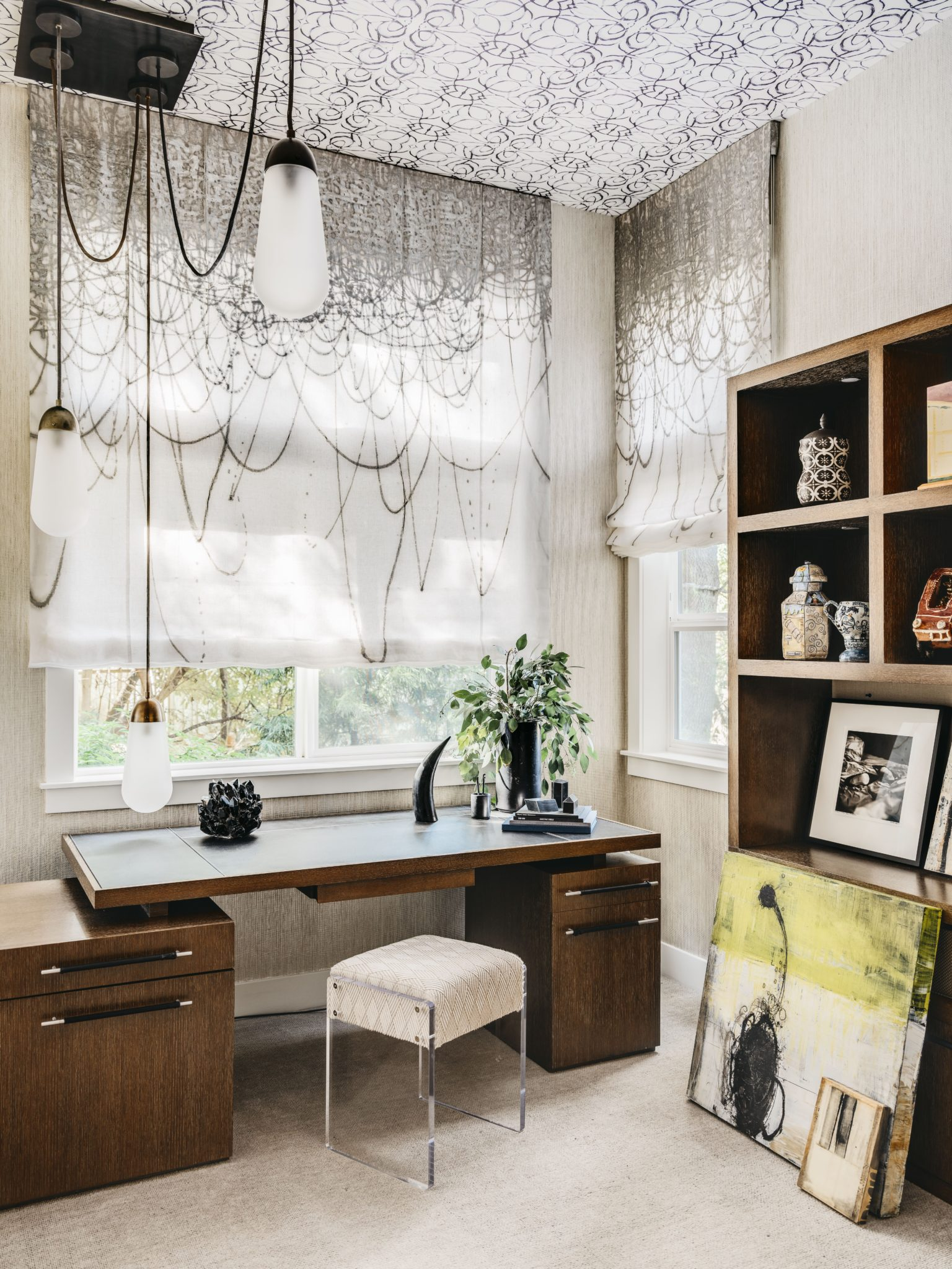 Home office with wallpapered ceiling, graphic shades, and contemporary wood desk by Holly A. Kopman Interior Design
