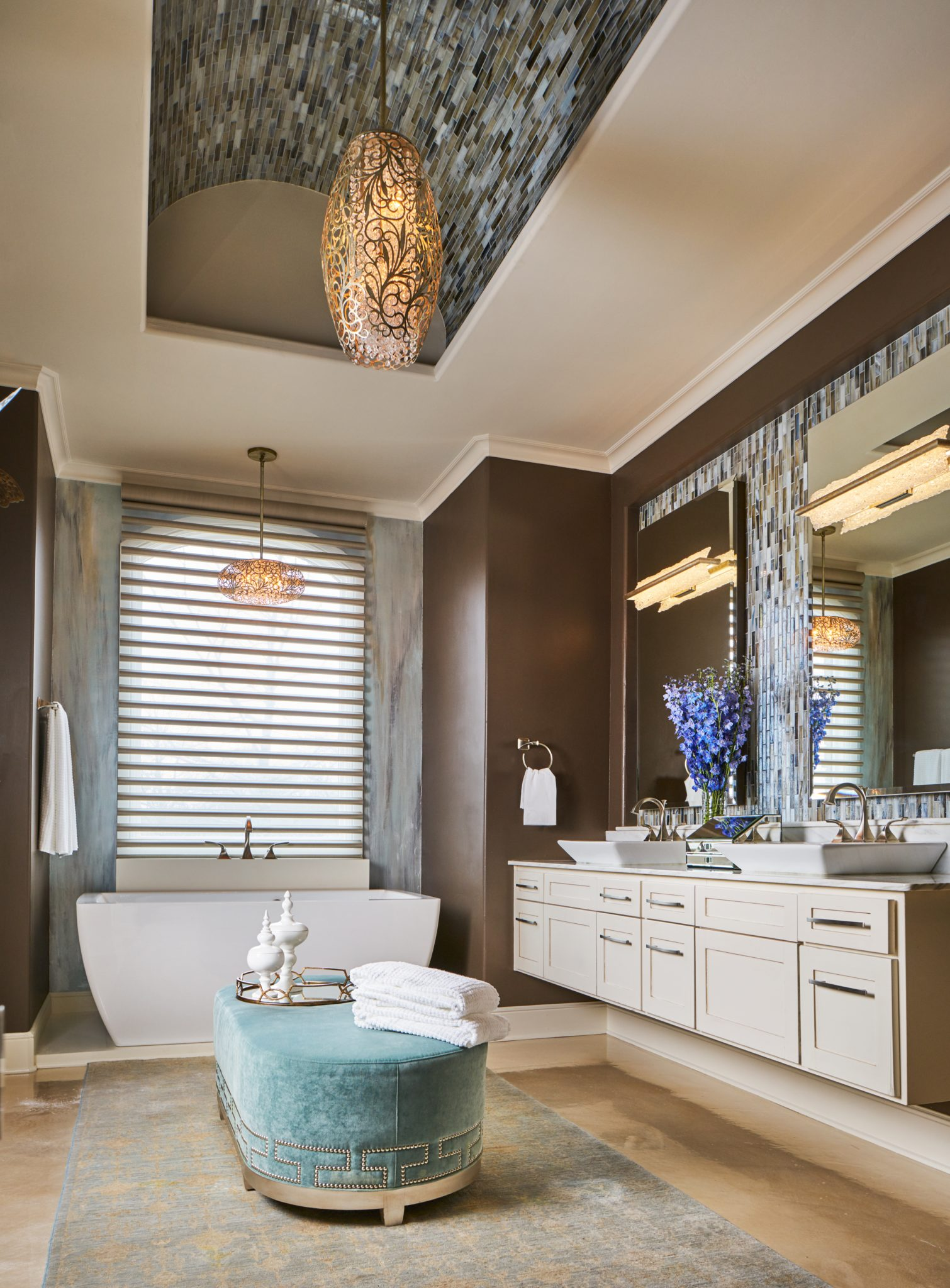 A glass tile barrel vault ceiling enlarges this already spacious master bath. by Wesley-Wayne Interiors