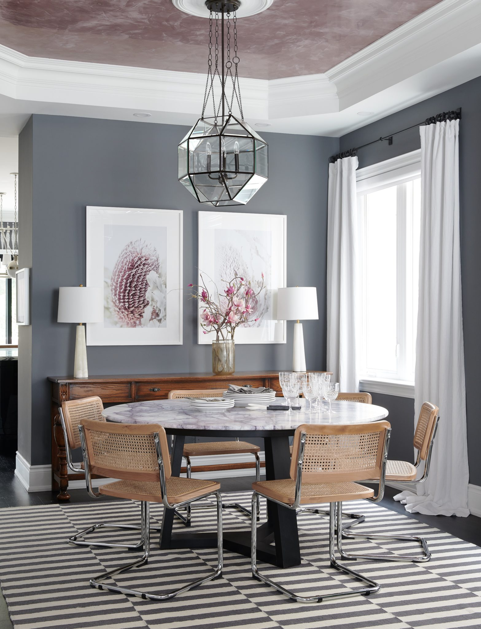 Mid-Century Dining Room with textured ceiling, glass pendant, grey palette by Estee Design