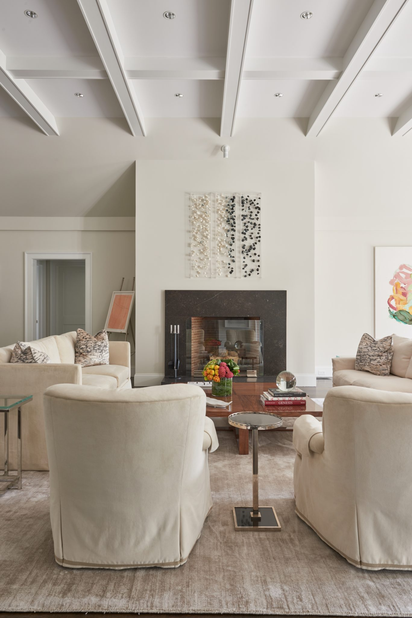 Family room with coffered ceiling by Huestis Tucker Architects, LLC