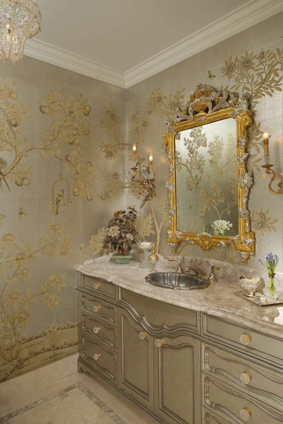 Of particular note is this powder room, which is adorned with hand-painted Chinese scenic wallpaper, a custom vanity decked in white quartz, an antique mirror, and mirrored sconces designed to echo the room's bird motif. By Sherry Hayslip Interiors & Hayslip Design Associates, Inc.