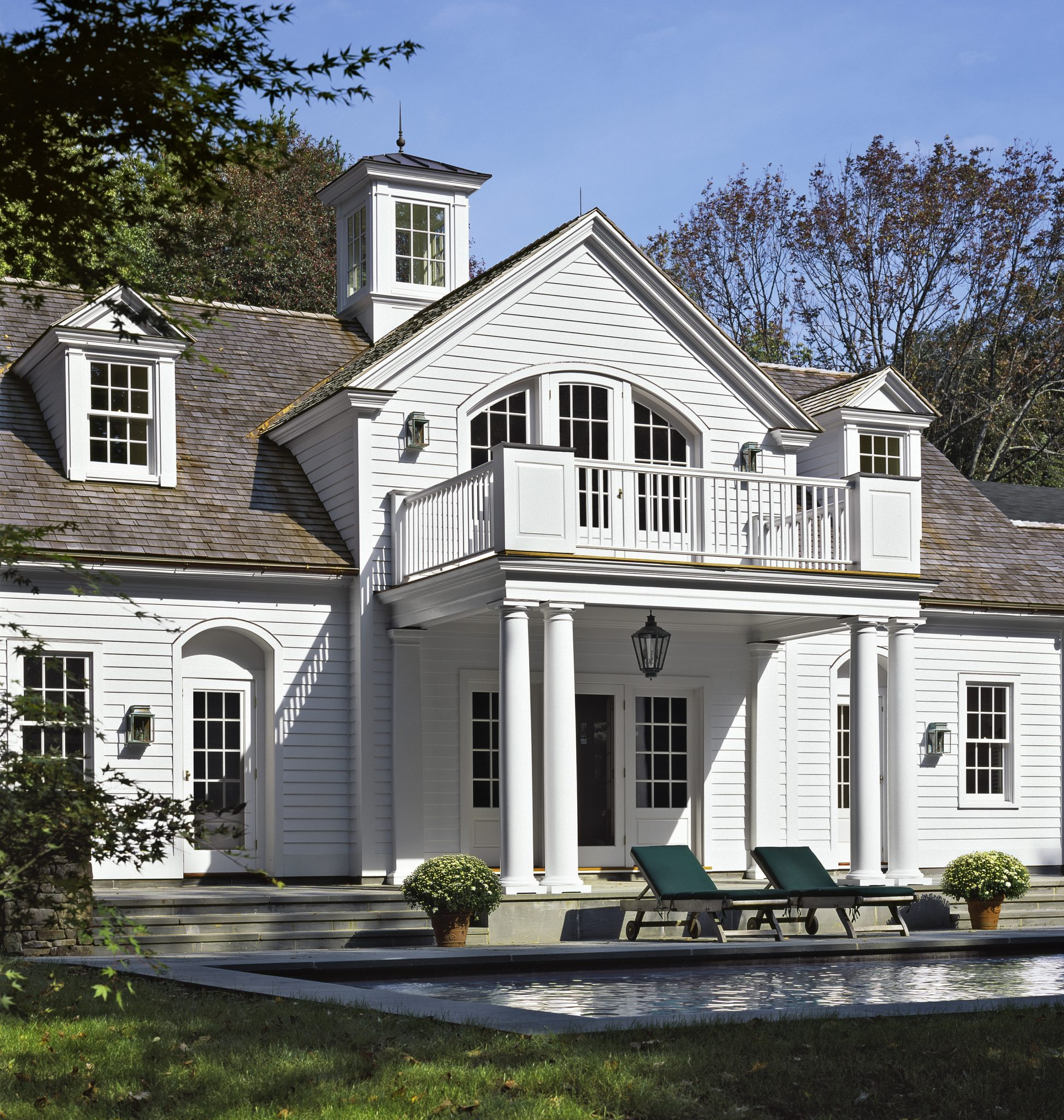 New classical Georgian pool house with portico and cupola. by Haver & Skolnick Architects