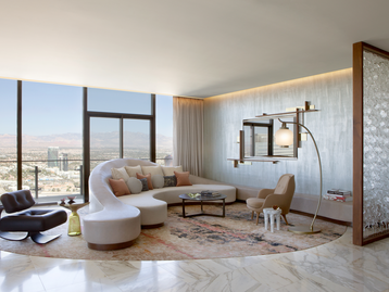 Cosmopolitan of Las Vegas - custom curved sofa, and shimmery plaster finish by Daun Curry