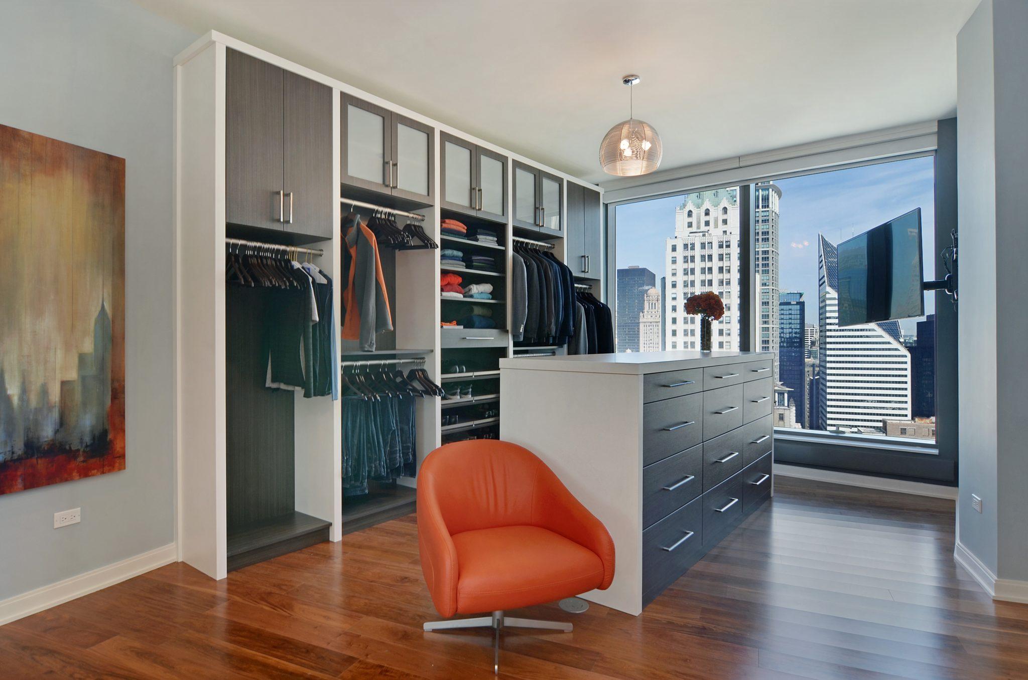 Urban organic Chicago high-rise master closet by Amanda Webster Design, Inc.