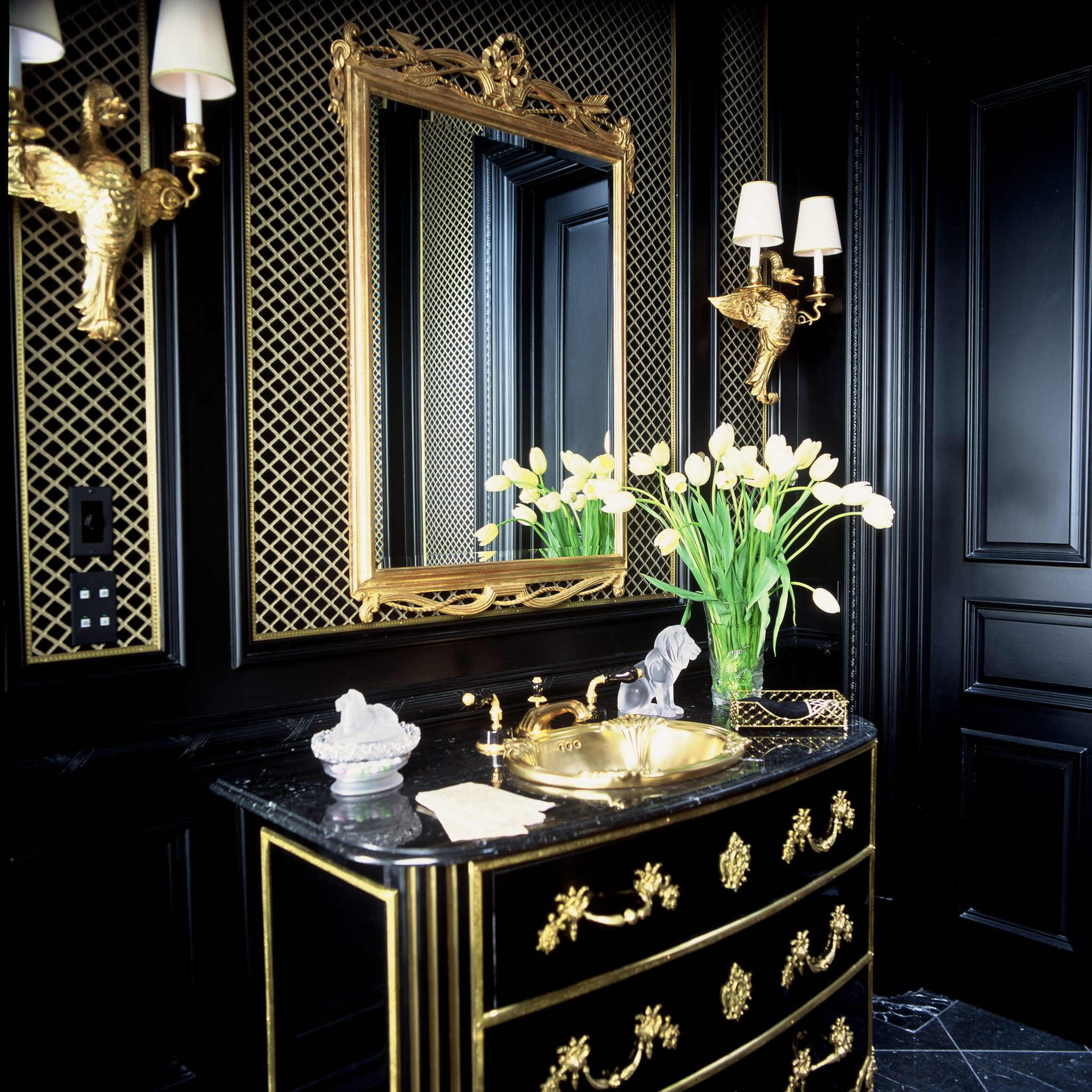 Bold vanity with French gold trim and accents. By Corley Design