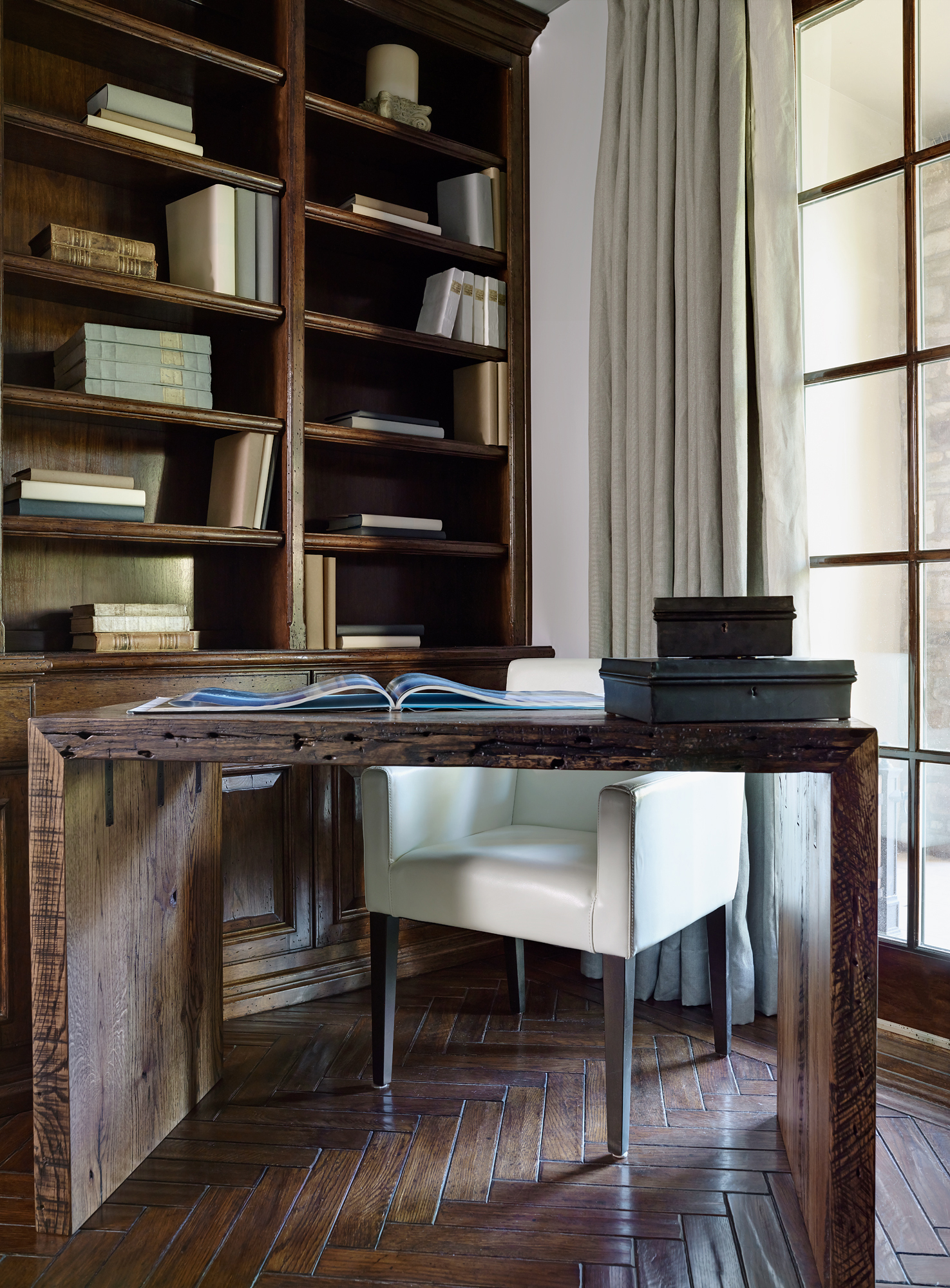 Rustic library with Parsons desk made out of reclaimed wood. By The Refined Group