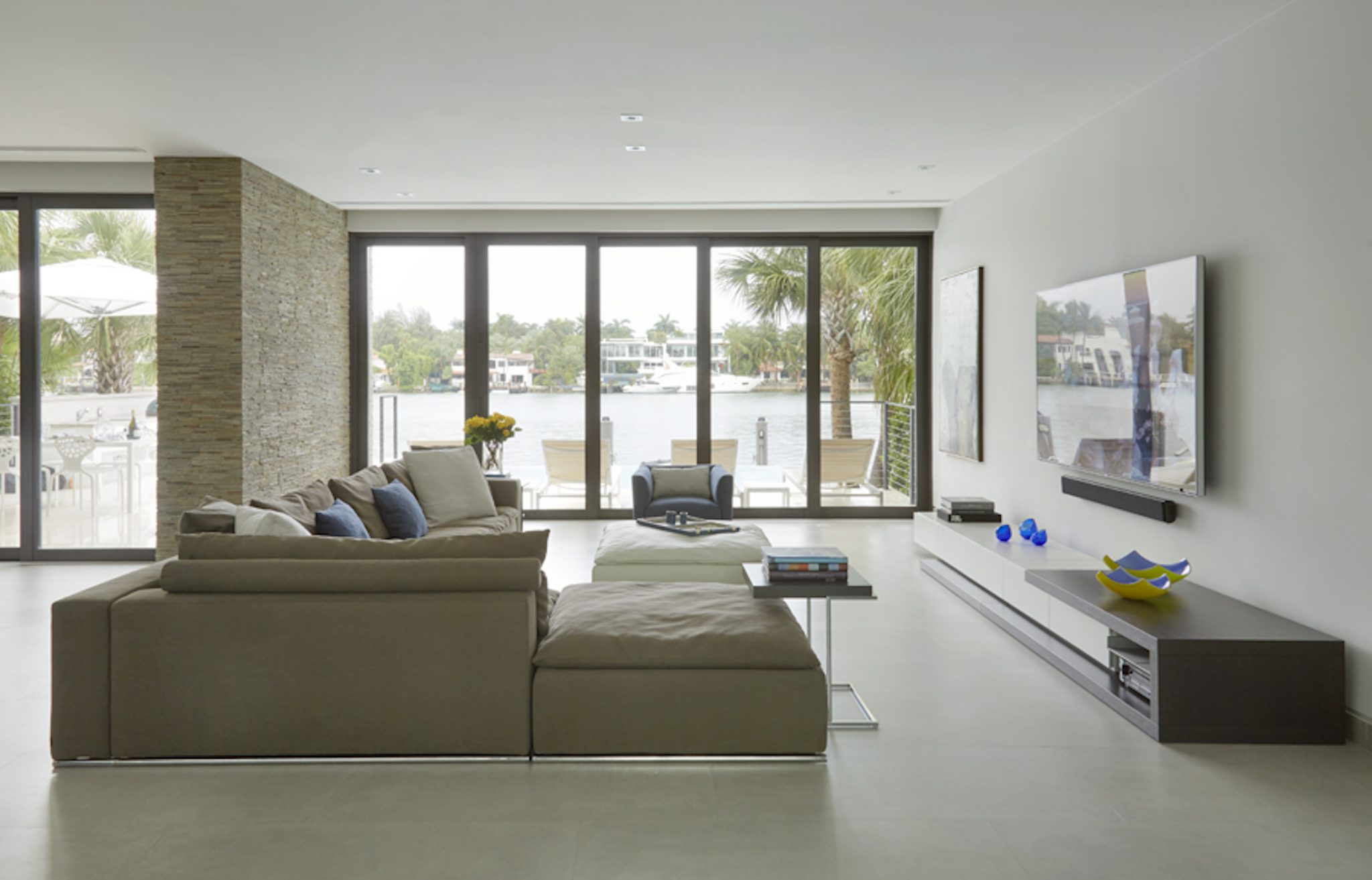 """The main level of the home is """"open plan."""" The spaces are pared down to feel spacious. By Dunagan Diverio Design Group"""