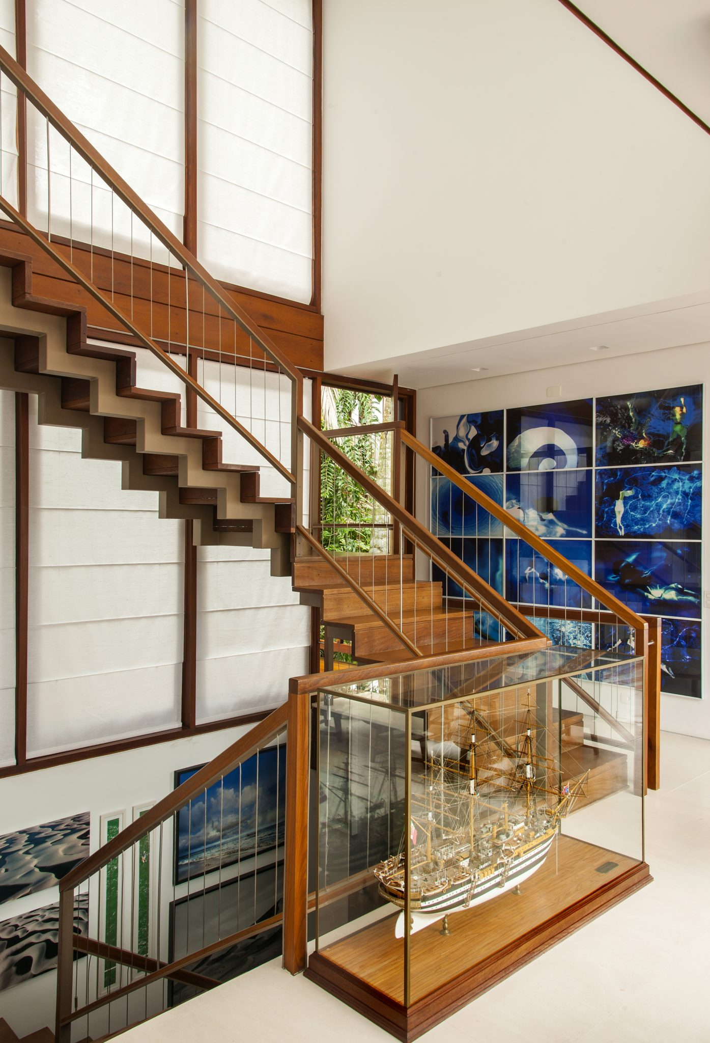Iporanga open wooden staircase with gallery wall by Sig Bergamin