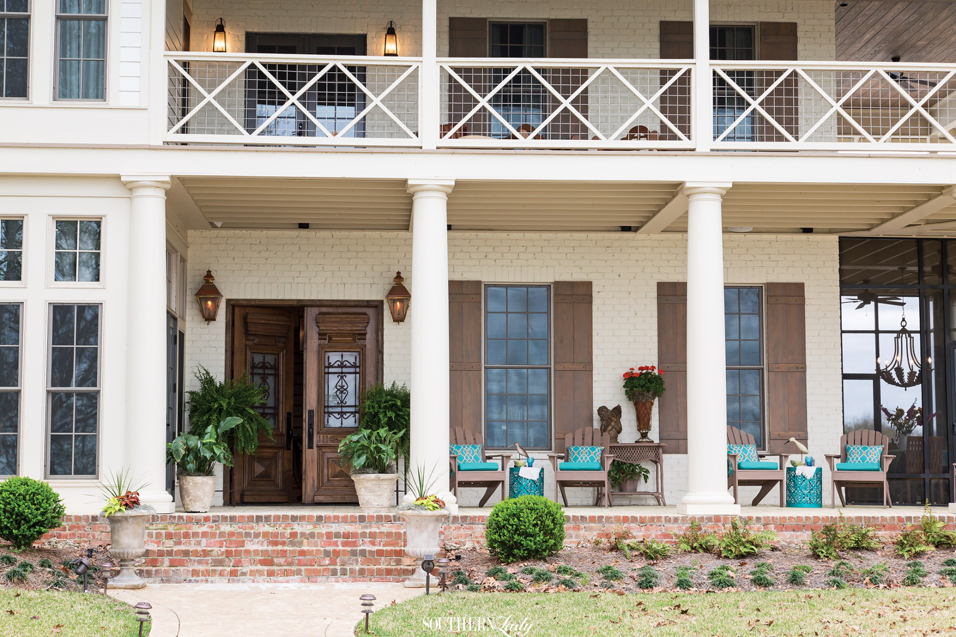 Front porches of low country house in Alabama by Cindy E. Barganier Interiors LLC
