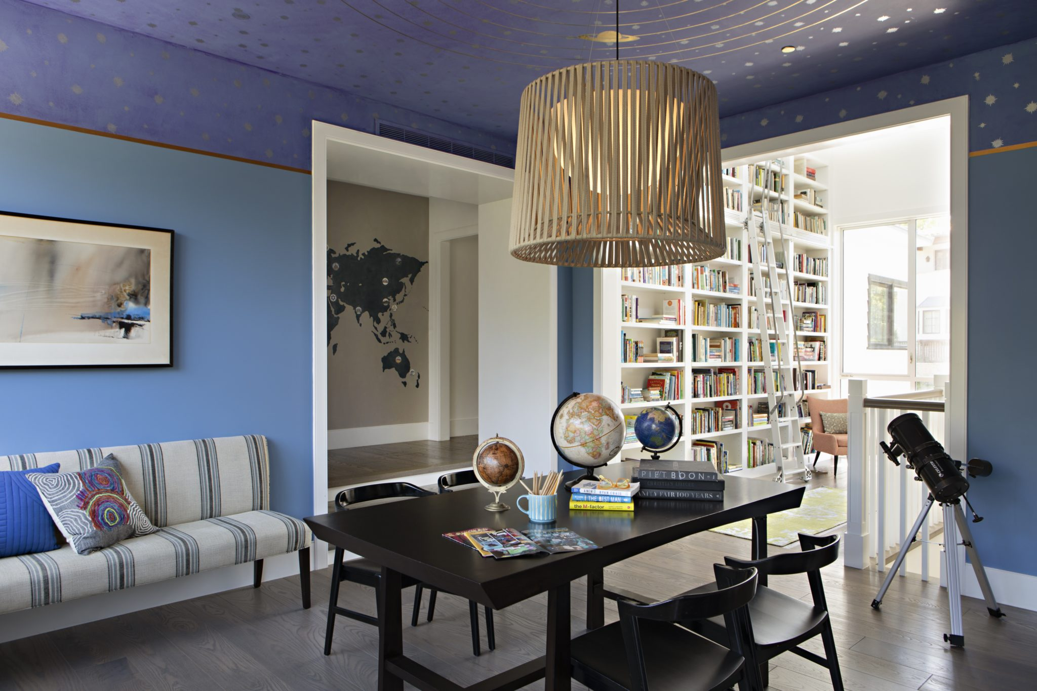 Children's reading homework room with celestial mural ceiling by SUBU Design Architecture