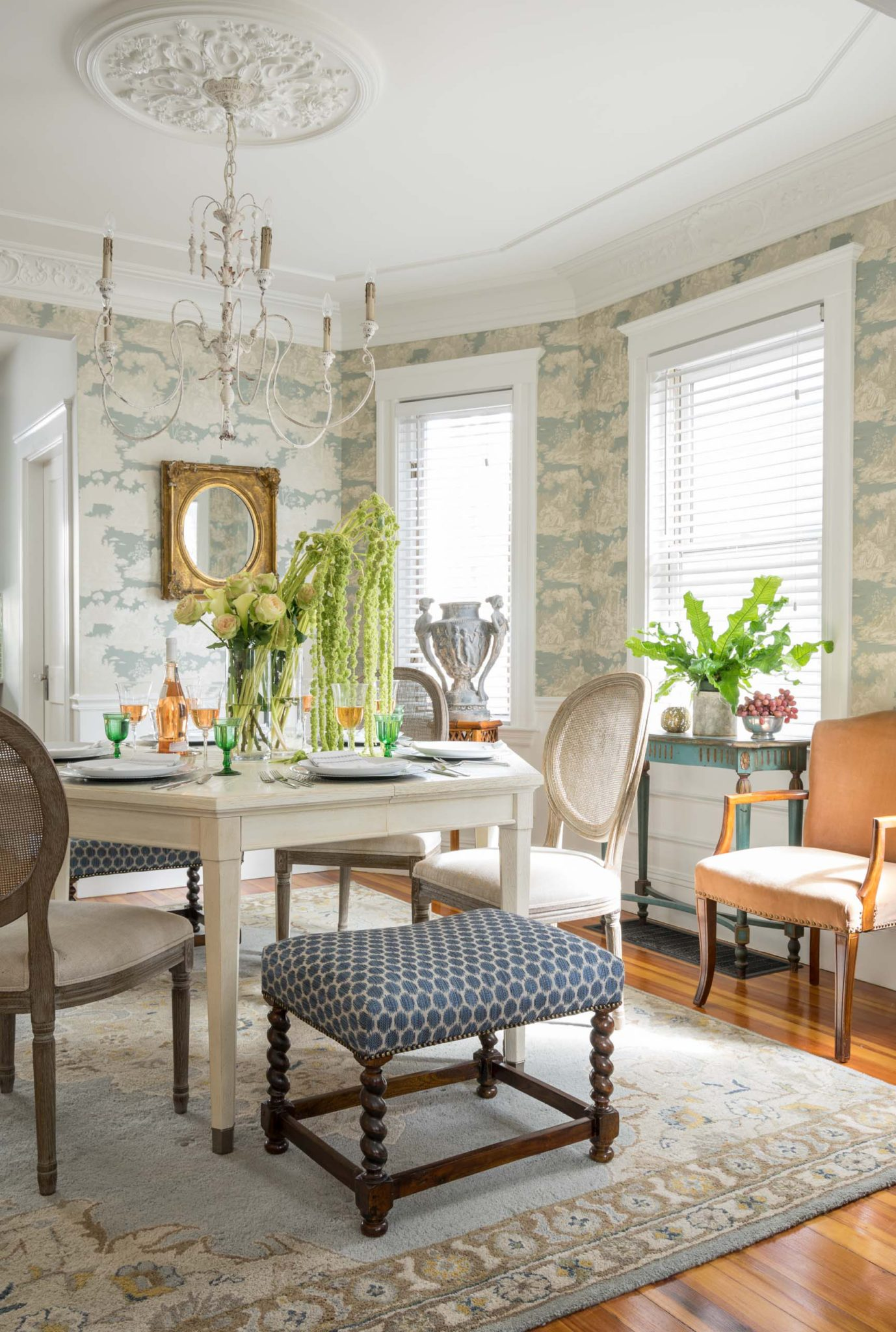 Bright dining room eclectic seating, molded ceiling rosette, elegant wallpaper by Dane Austin Design